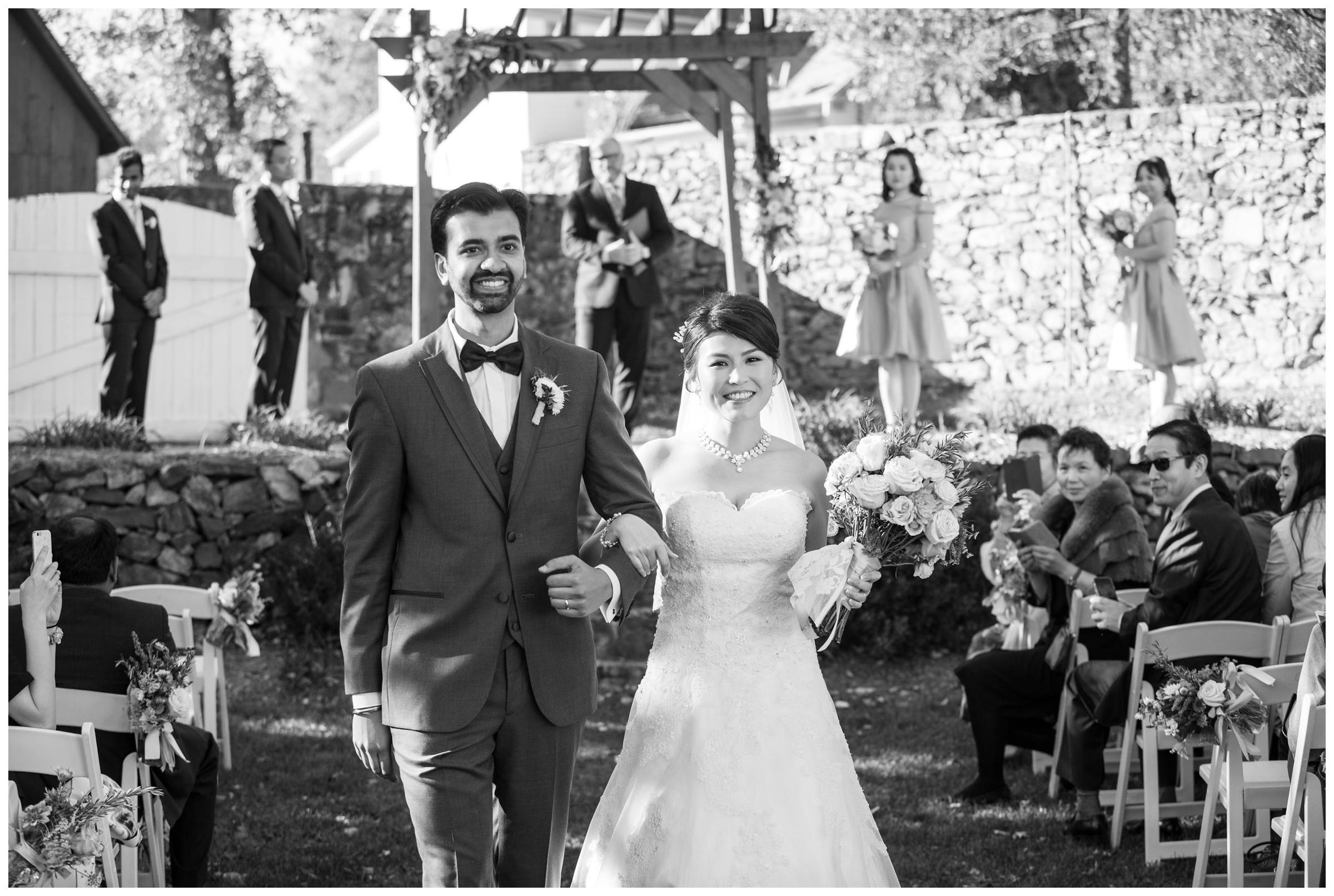 Recessional during rustic outdoor wedding ceremony.