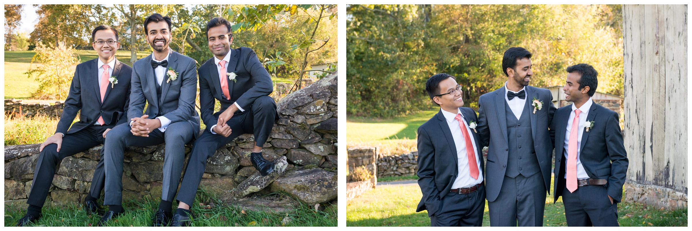 Portrait of groomsmen near stone ruins at rustic wedding.