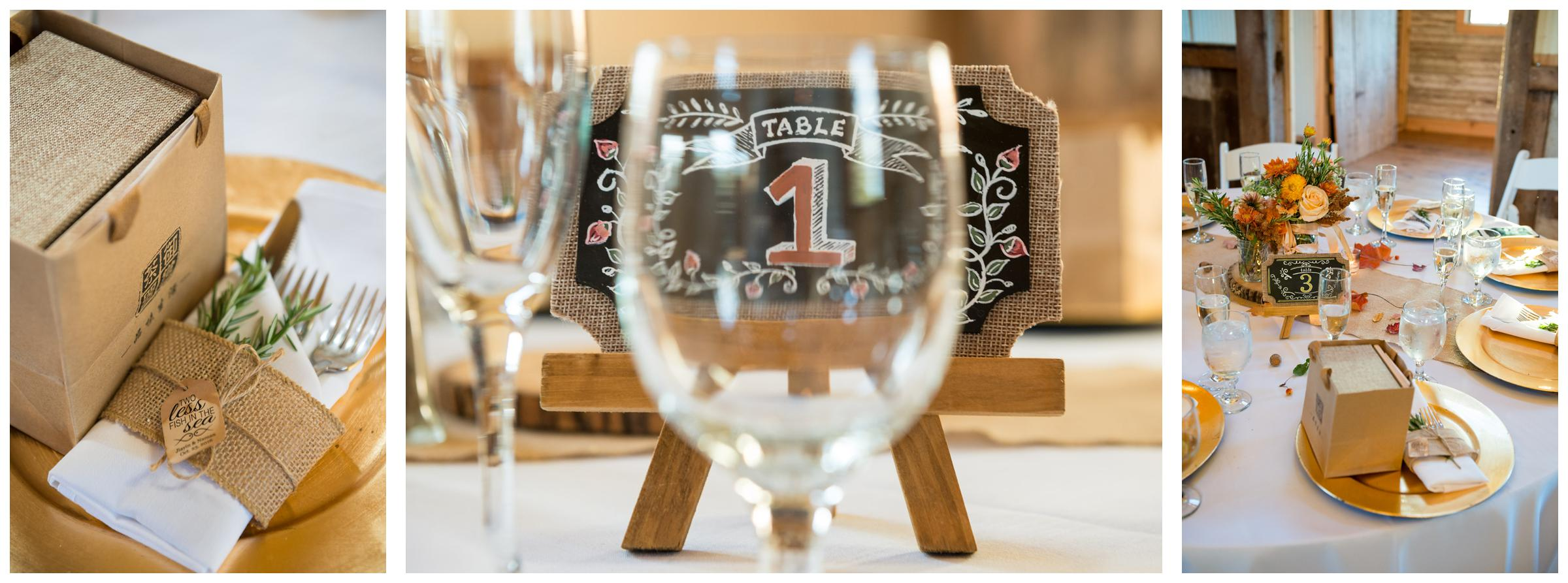 Rustic chalkboard table number signs at barn wedding.