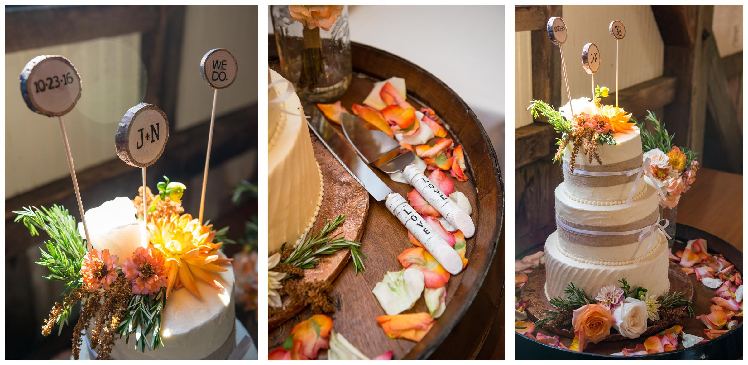 Rustic cake on barrel table with wooden topper and cake cutter.