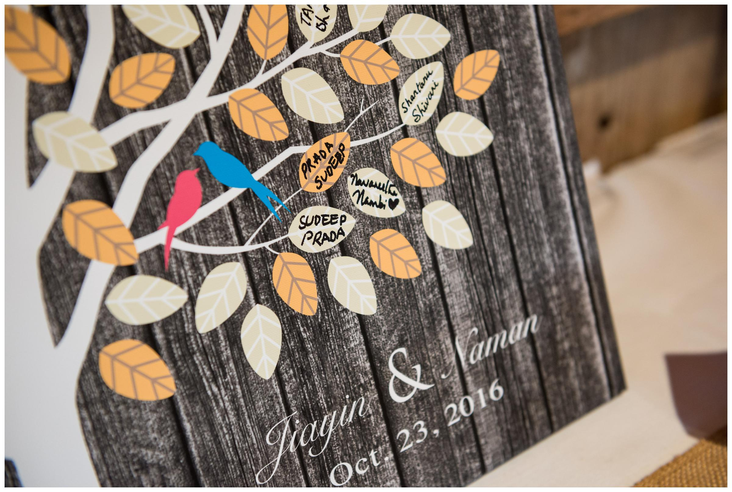 Canvas tree signature guestbook at rustic wedding.