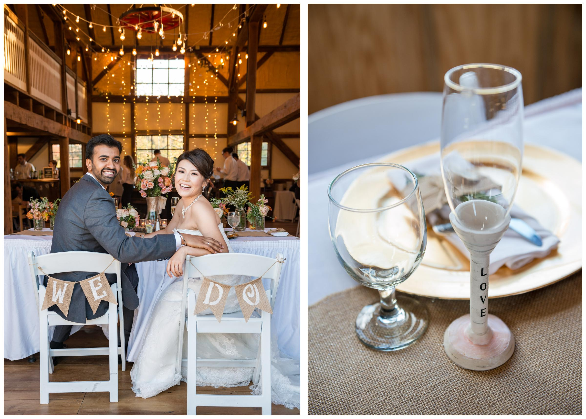 Bride and groom with twinkle lights at rustic wedding reception in barn at Stoneleigh Golf Club
