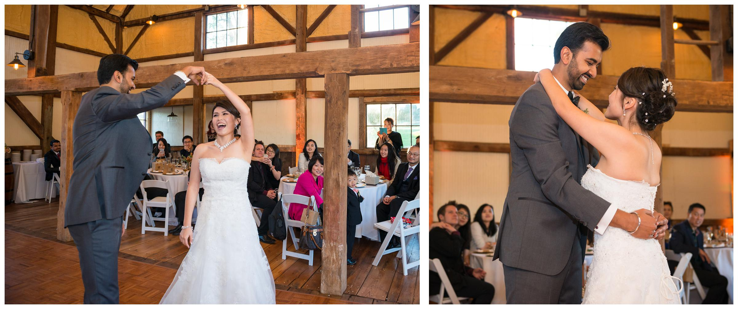 Bride and groom have their first dance during rustic barn reception at Stoneleigh Golf Club in Round Hill, Virginia.