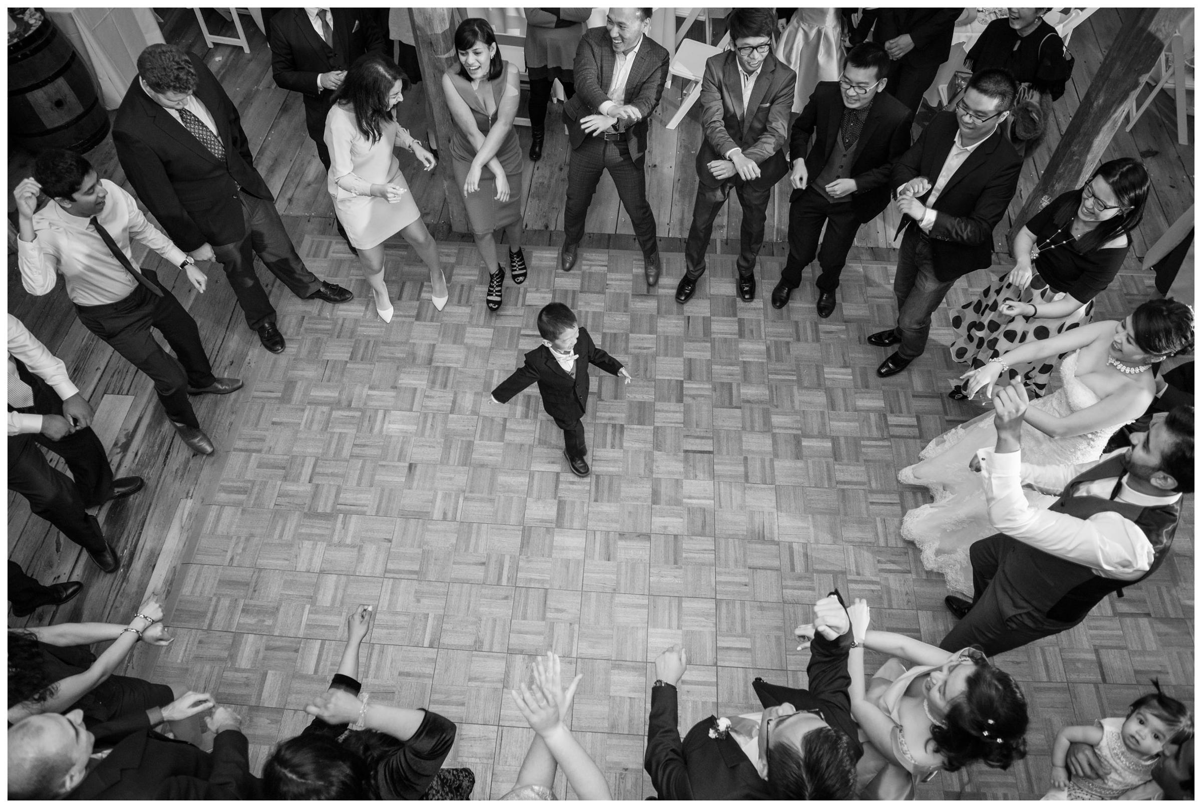 The ring bearer danced in the center of the floor during a rustic wedding reception.