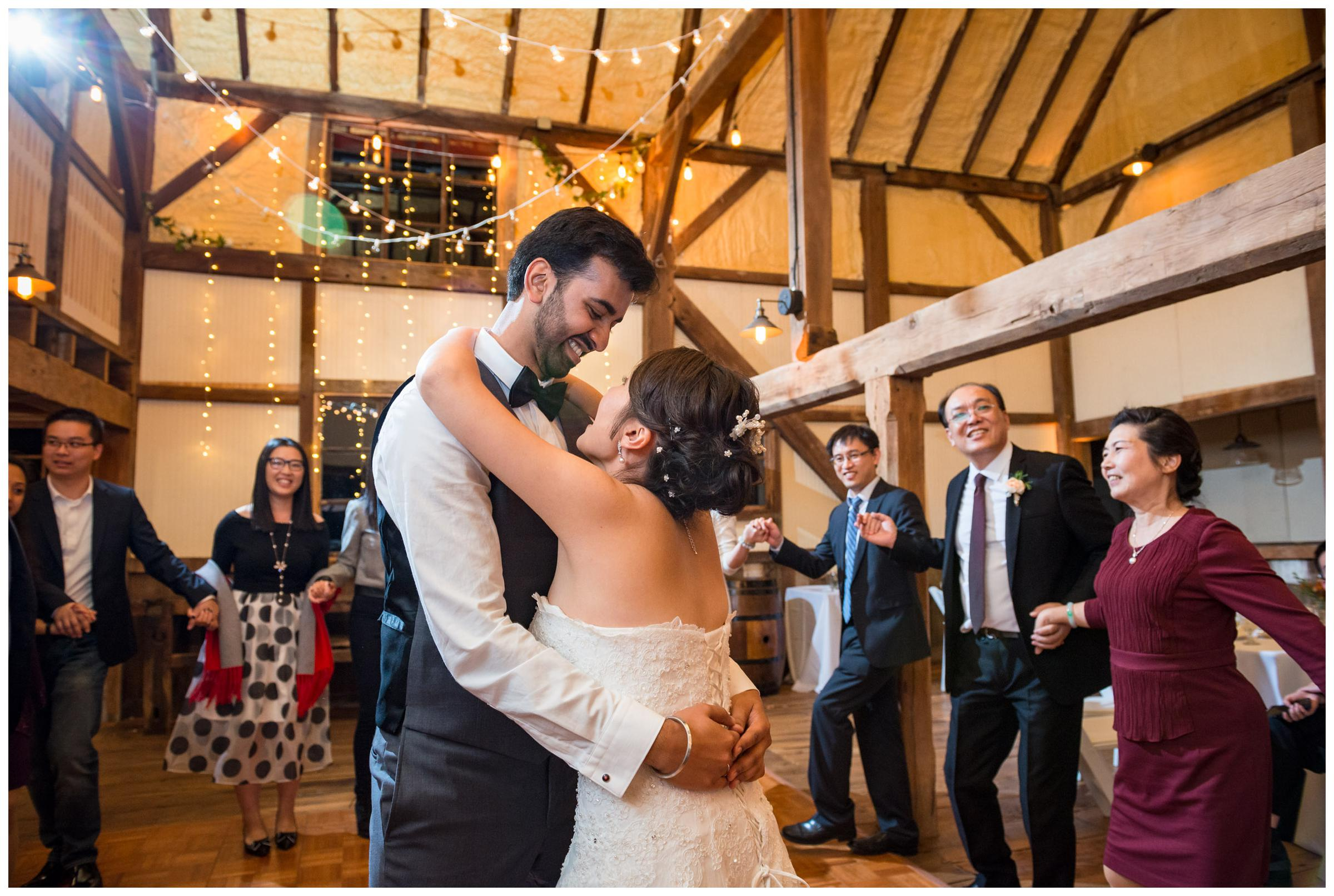Bride and groom dancing during their rustic barn wedding reception.