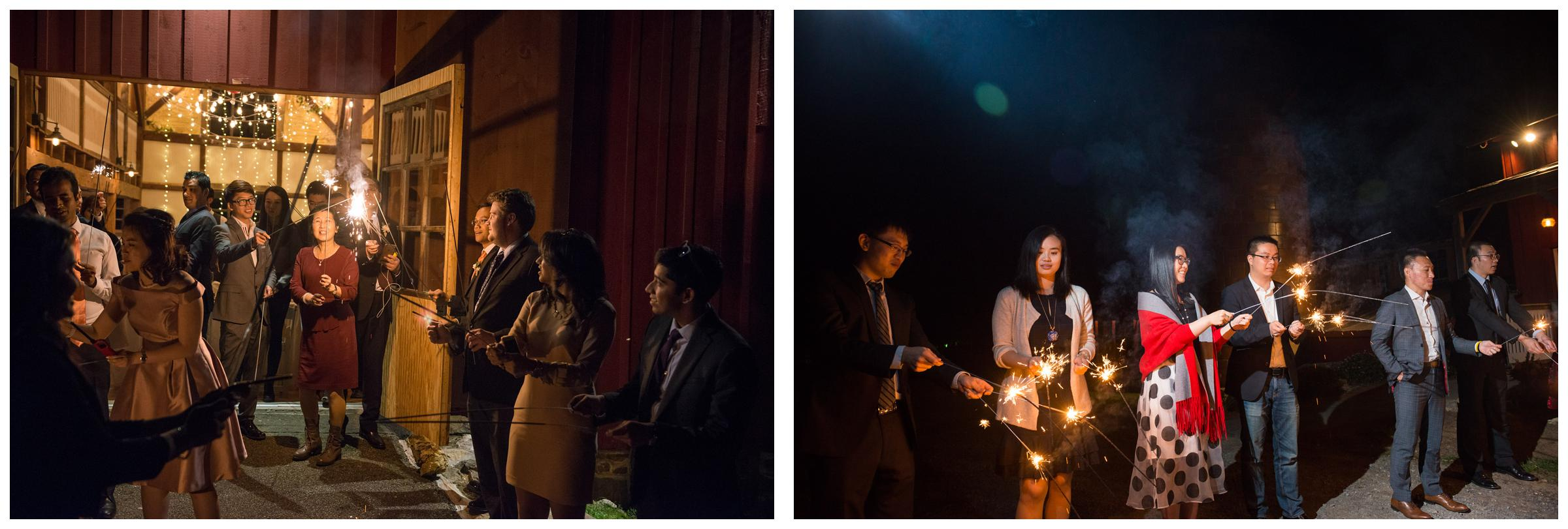 Wedding guests light sparklers in preparation for the bride and groom's grand exit.