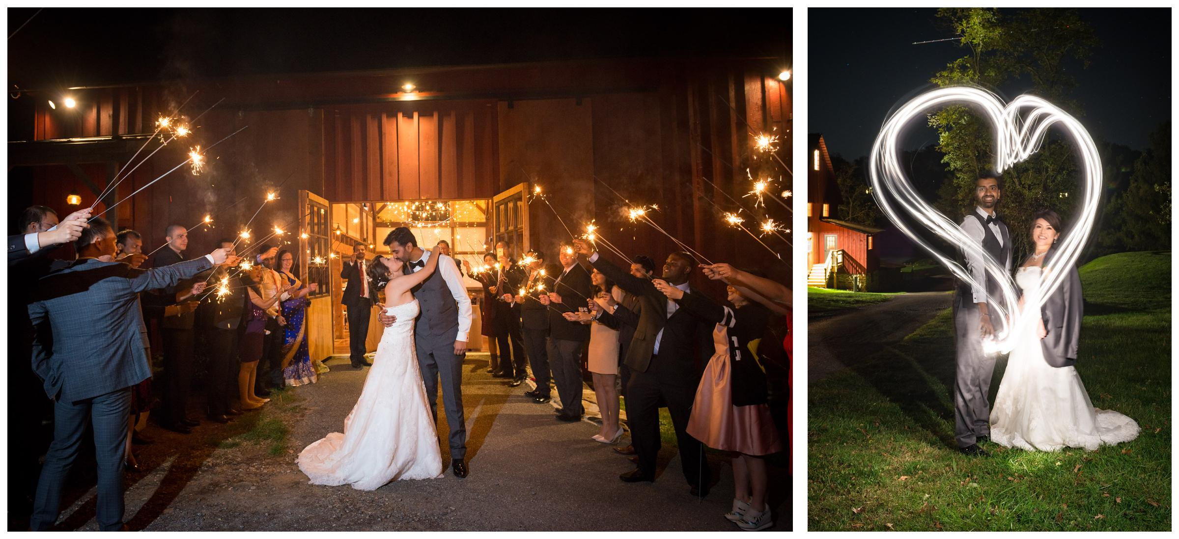Sparkler exit from rustic wedding reception in barn and light painted heart around newlyweds.