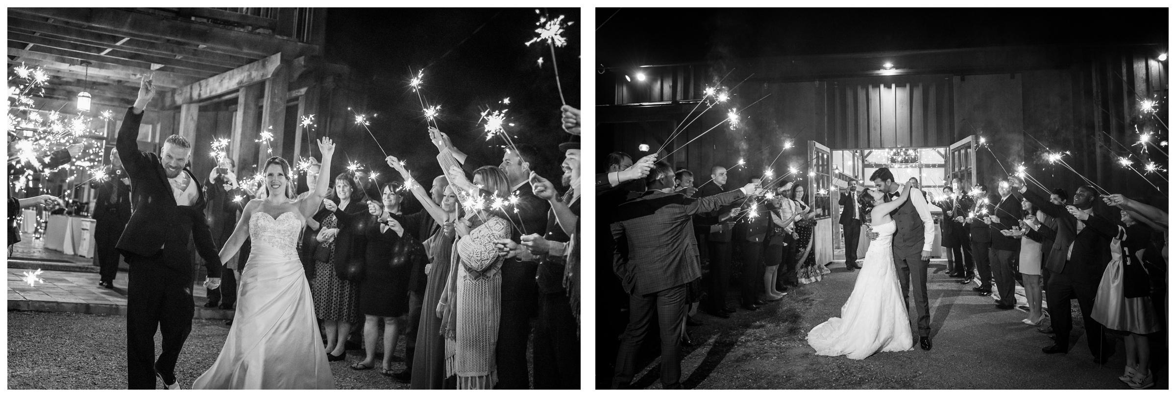 wedding guests cheering during bride and groom's sparkler exit