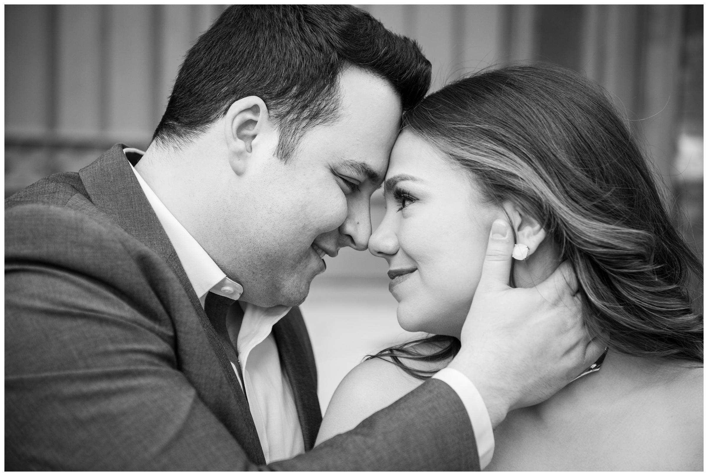 couple snuggling during classy and elegant urban engagement session