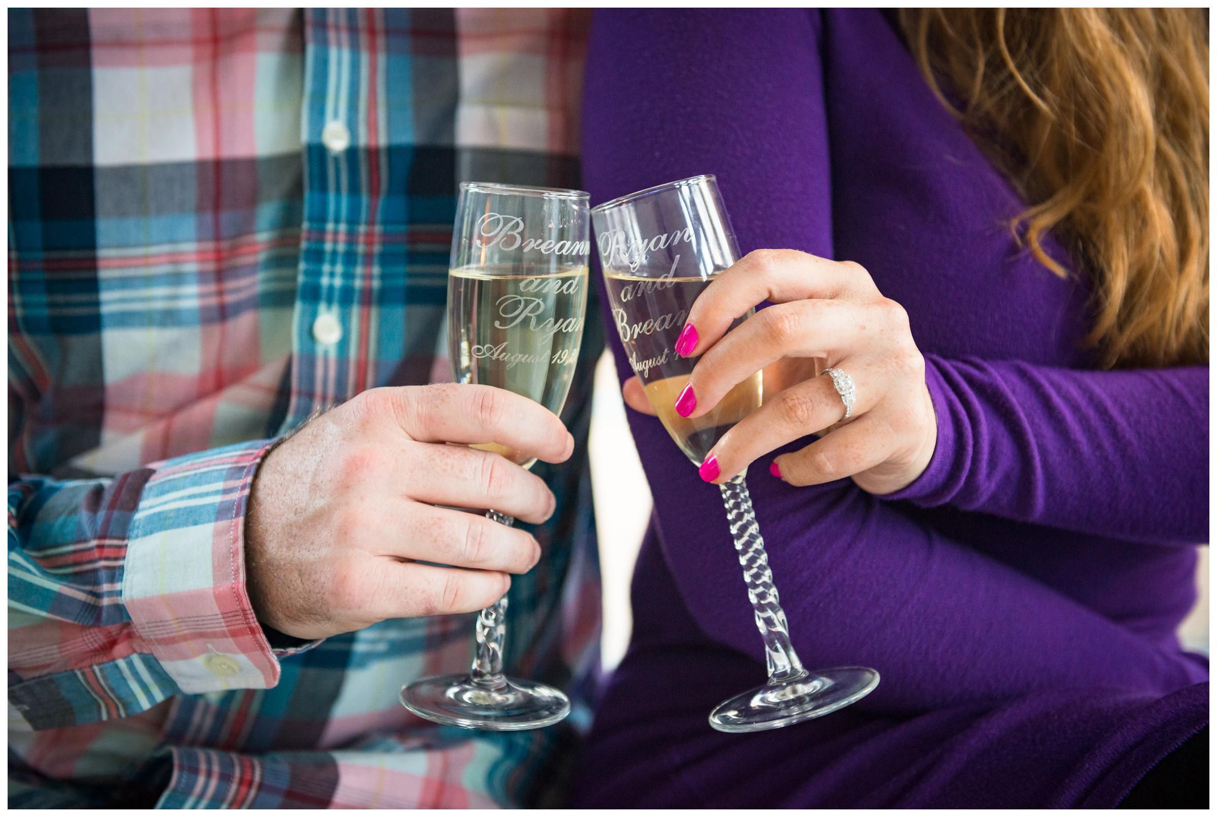 Engaged couple cheers with personalized champagne flutes