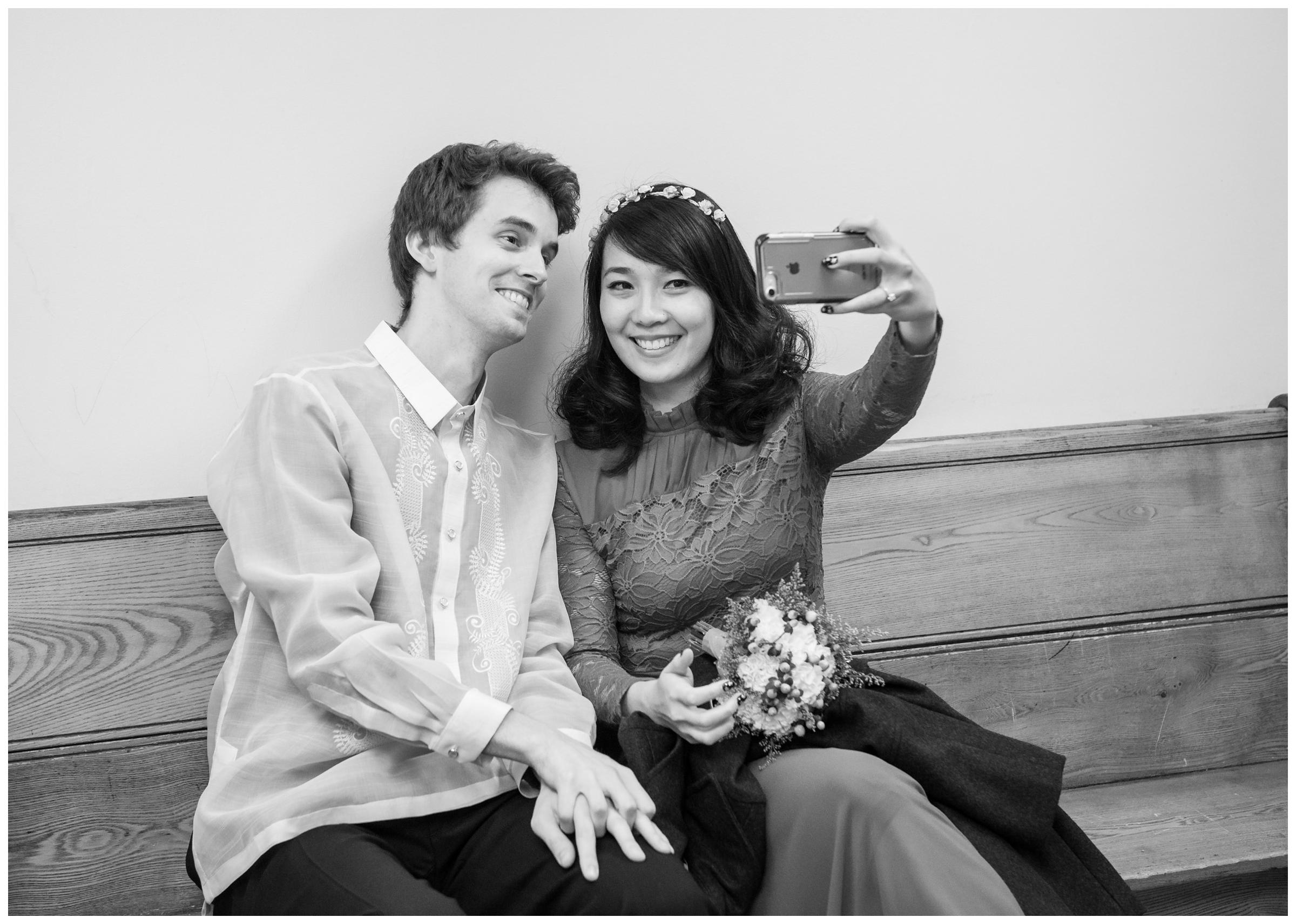 bride and groom taking selfie before elopement wedding at Montgomery County Courthouse in Rockville, Maryland
