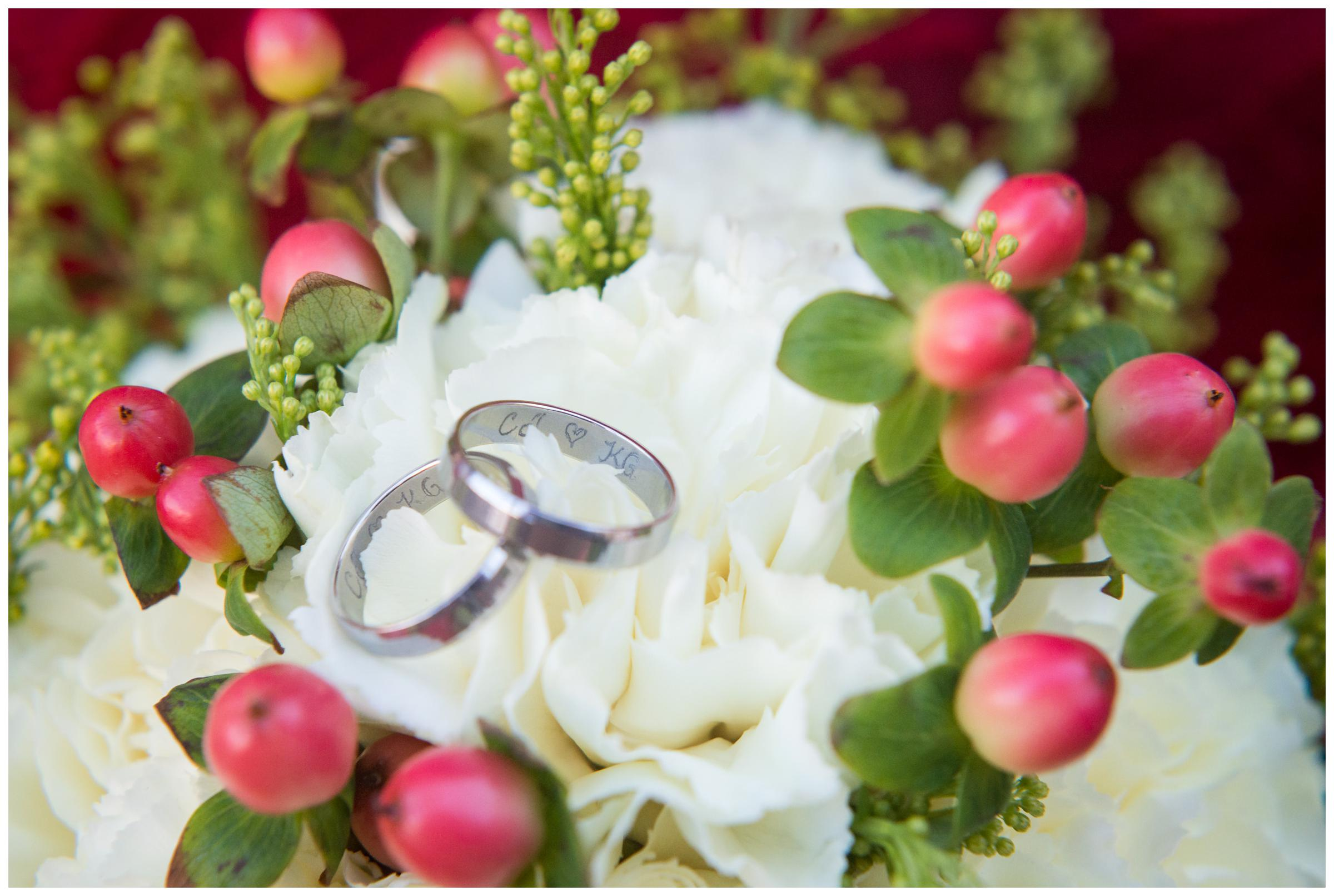 engraved wedding rings on bouquet
