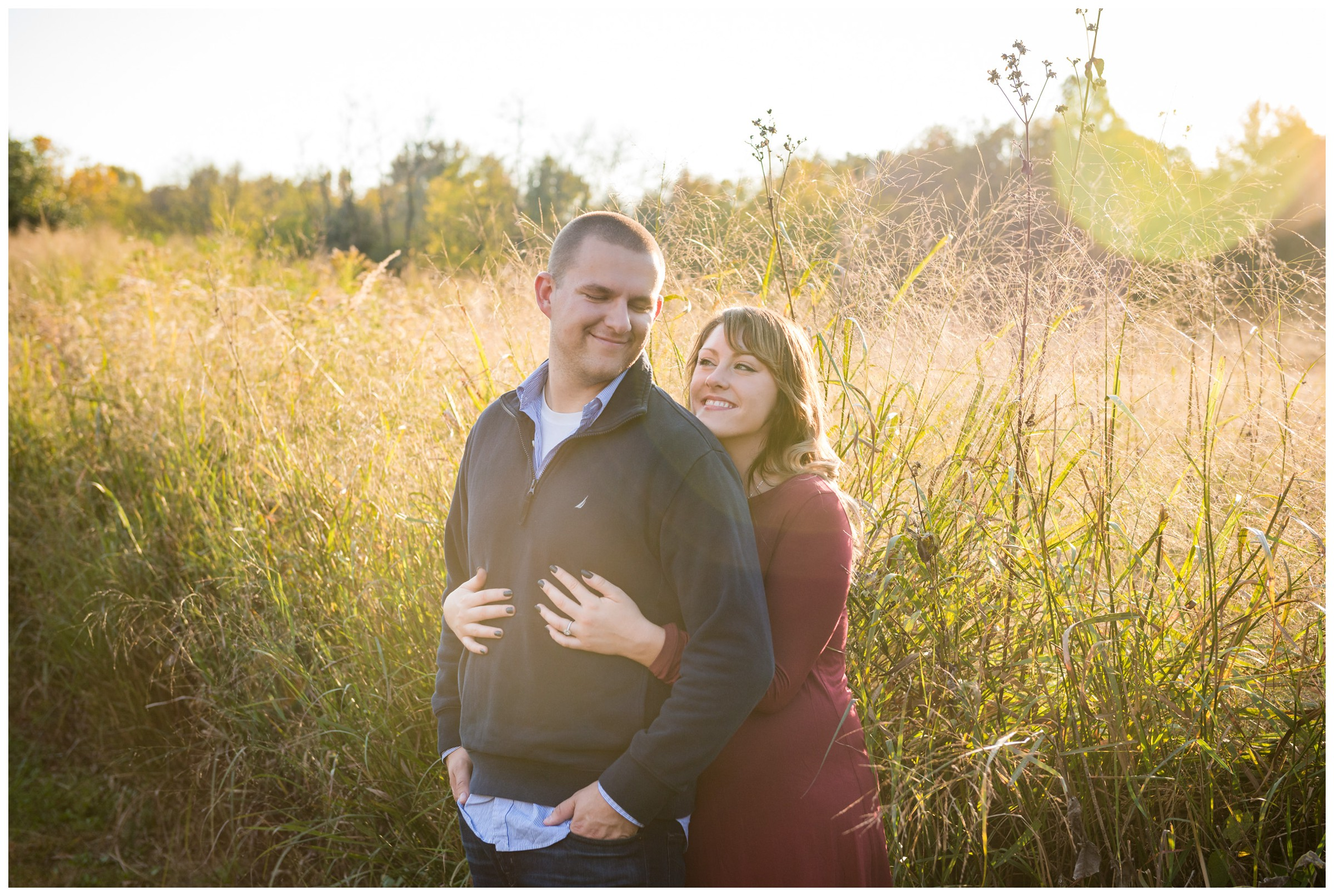 engagement photos in field at sunset in Fredericksburg, Virginia