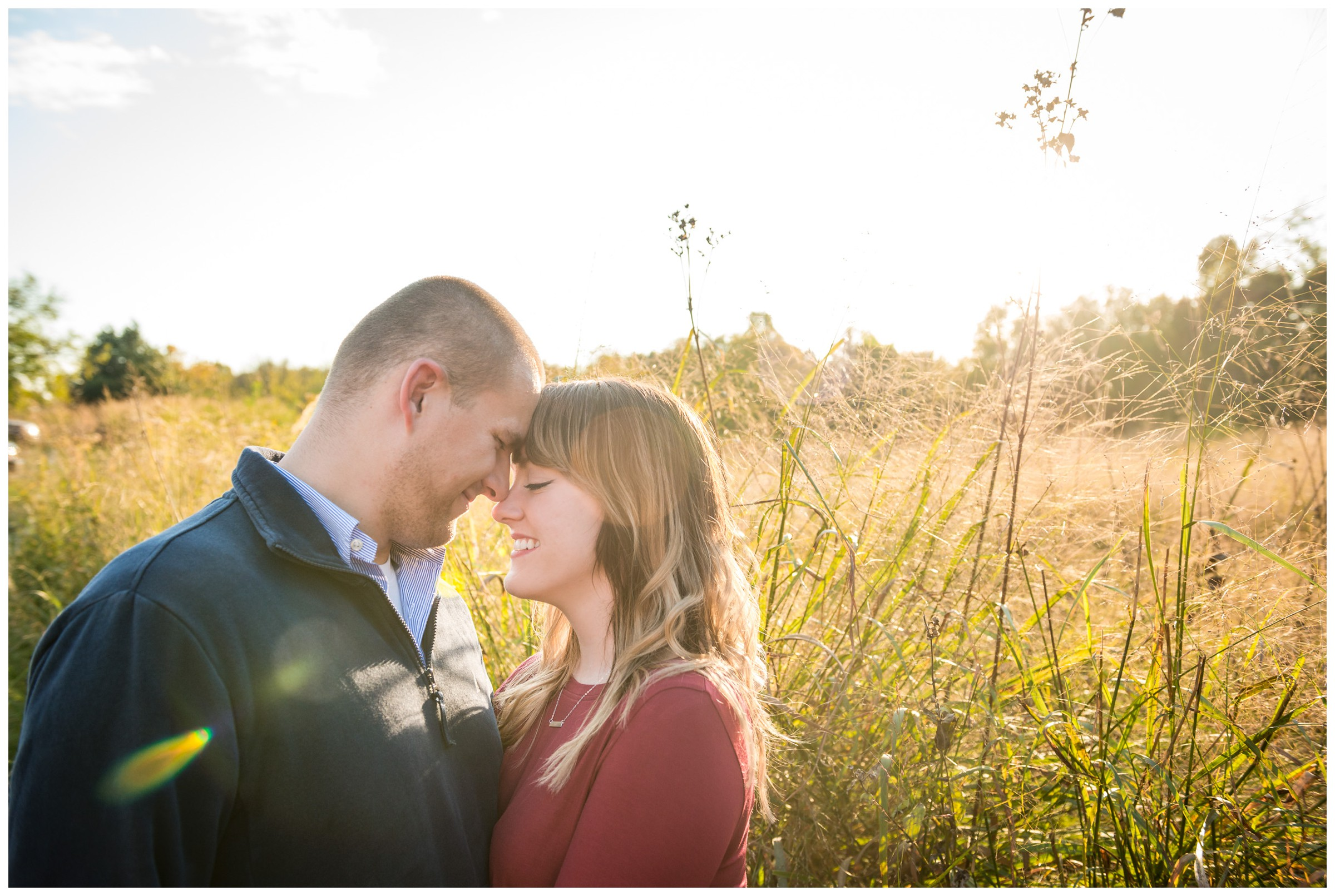 fall engagement photos in field at sunset in Fredericksburg, Virginia