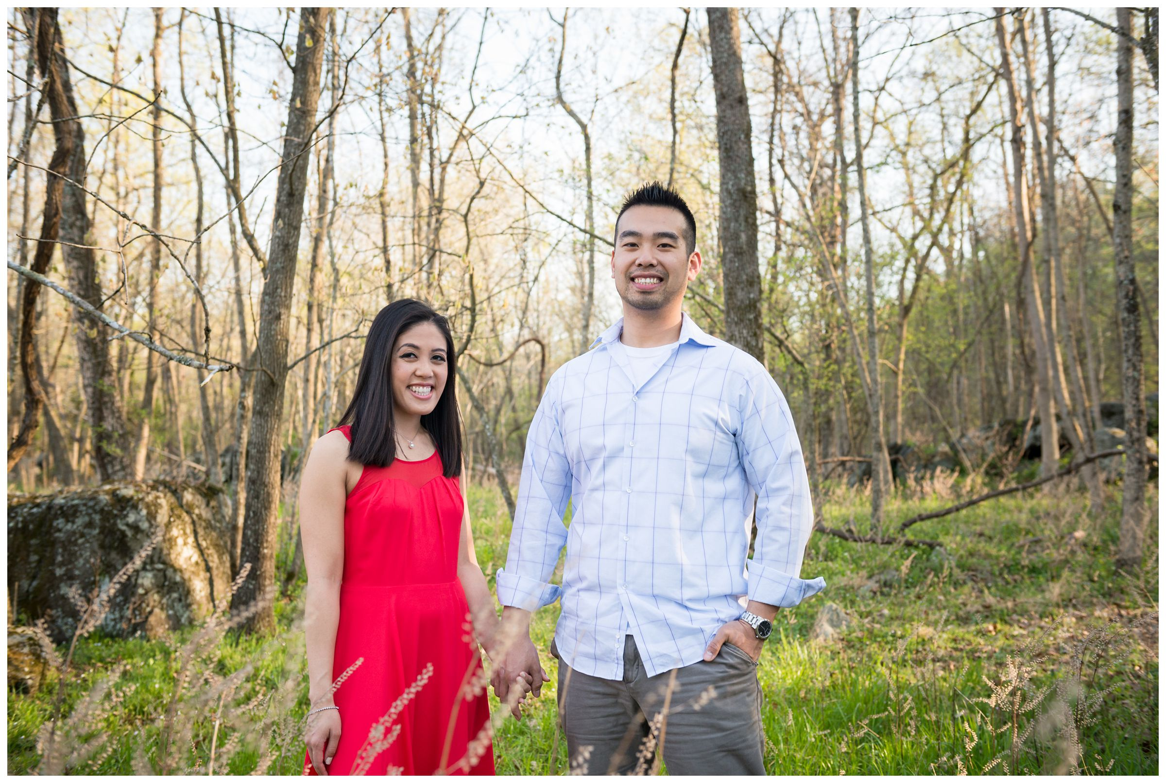 engaged couple in forest at Great Falls Park in Virginia