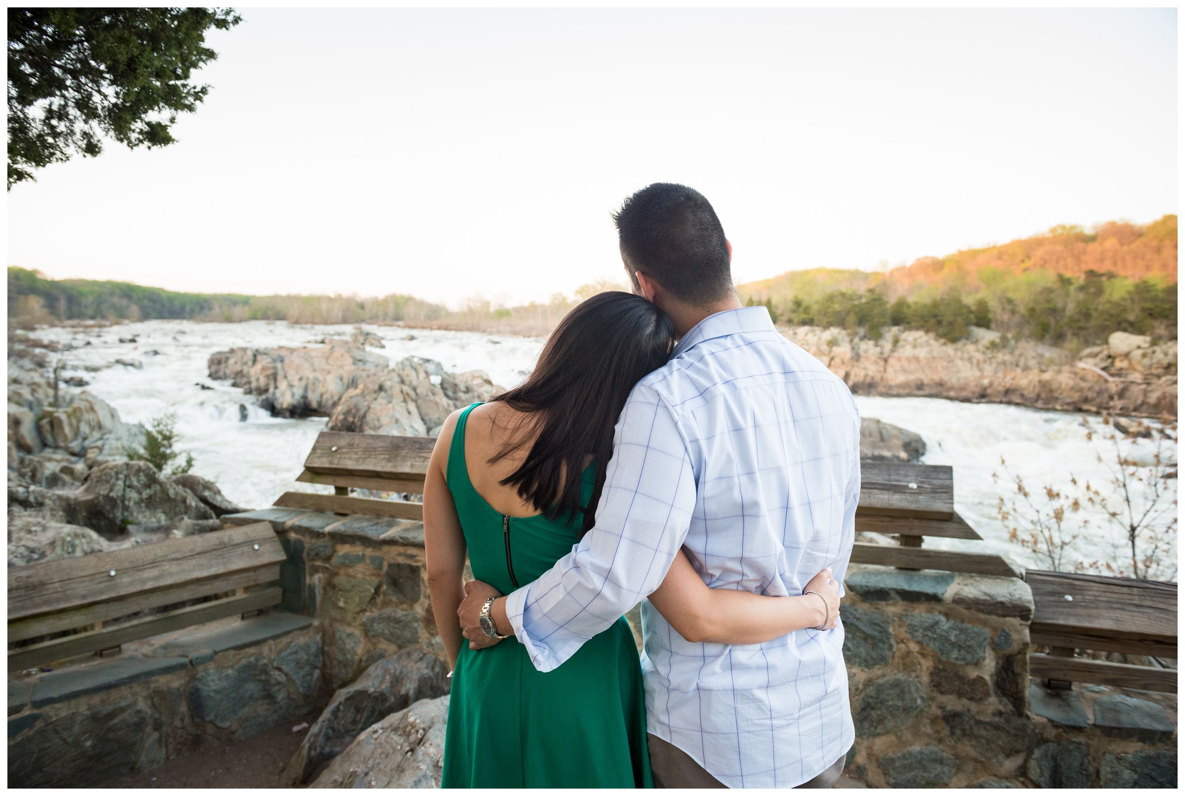 engaged couple along river overlook at Great Falls Park in Northern Virginia