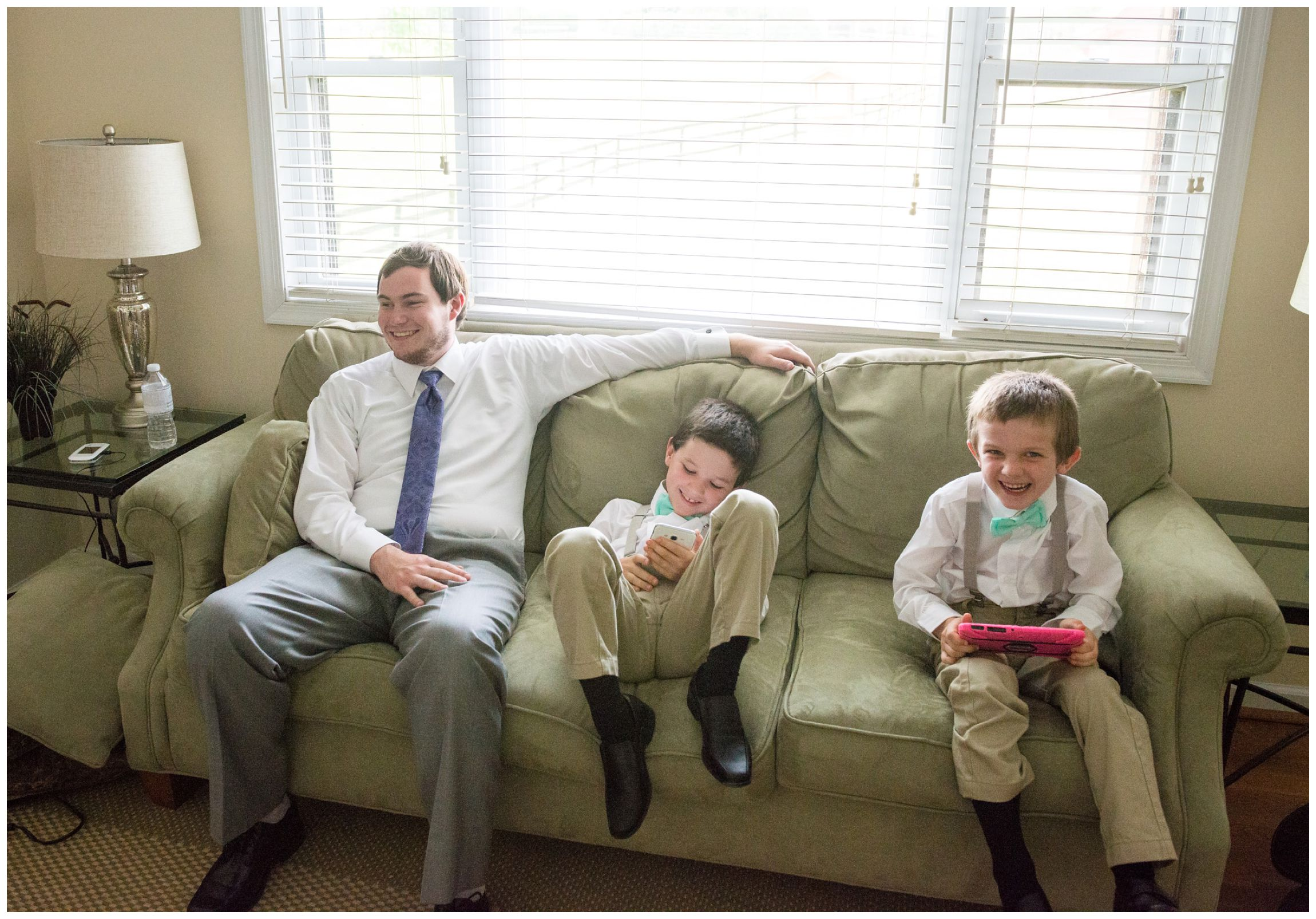 groom hangs out with ring bearers before wedding ceremony