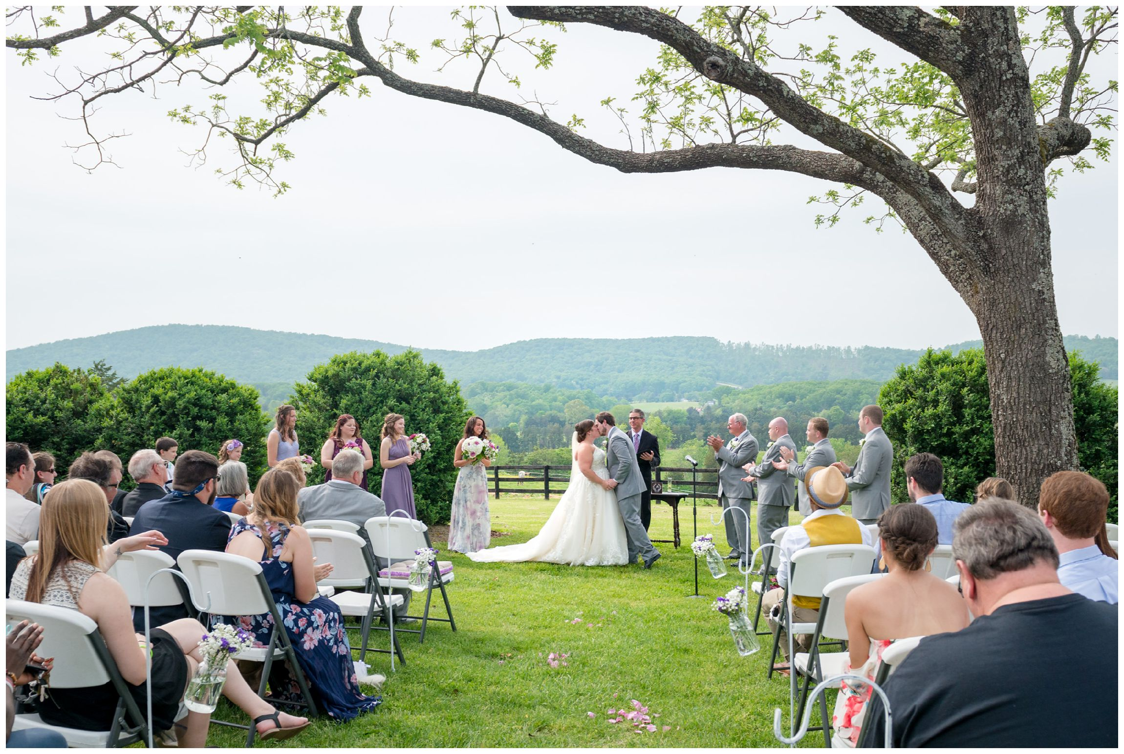 first kiss during rustic spring wedding with mountain views at Wolftrap Farm in Gordonsville, Virginia