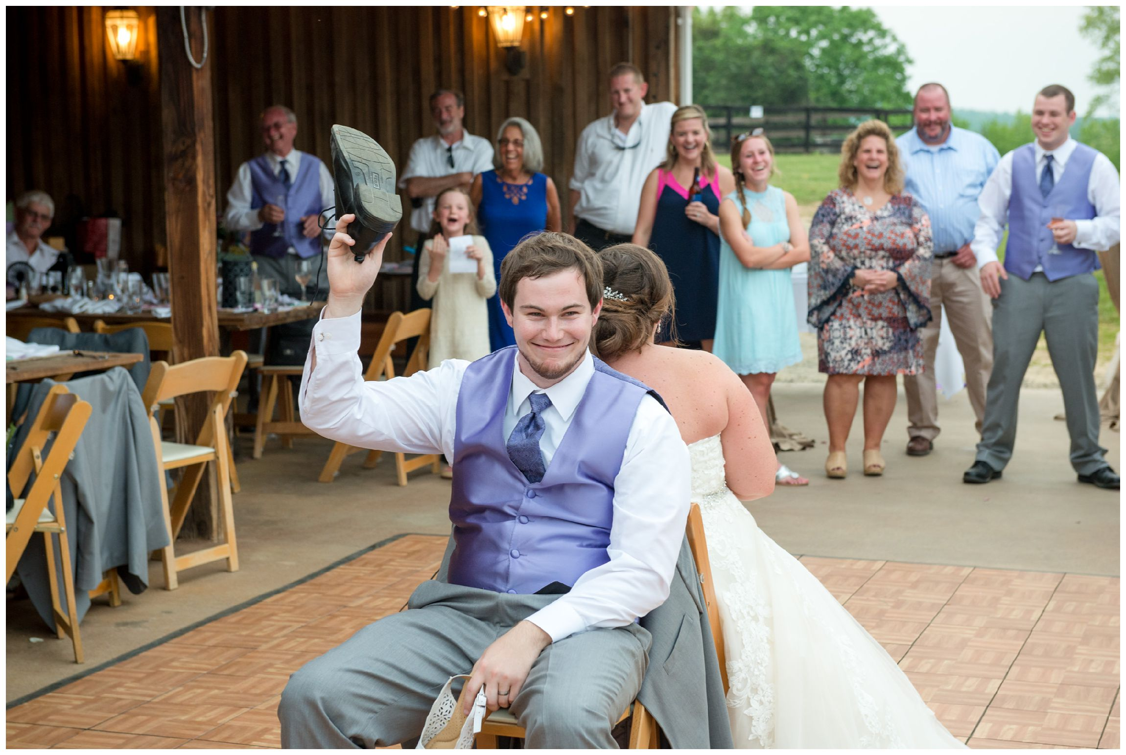 bride and groom play shoe game at barn wedding reception at Wolftrap Farm in Virginia