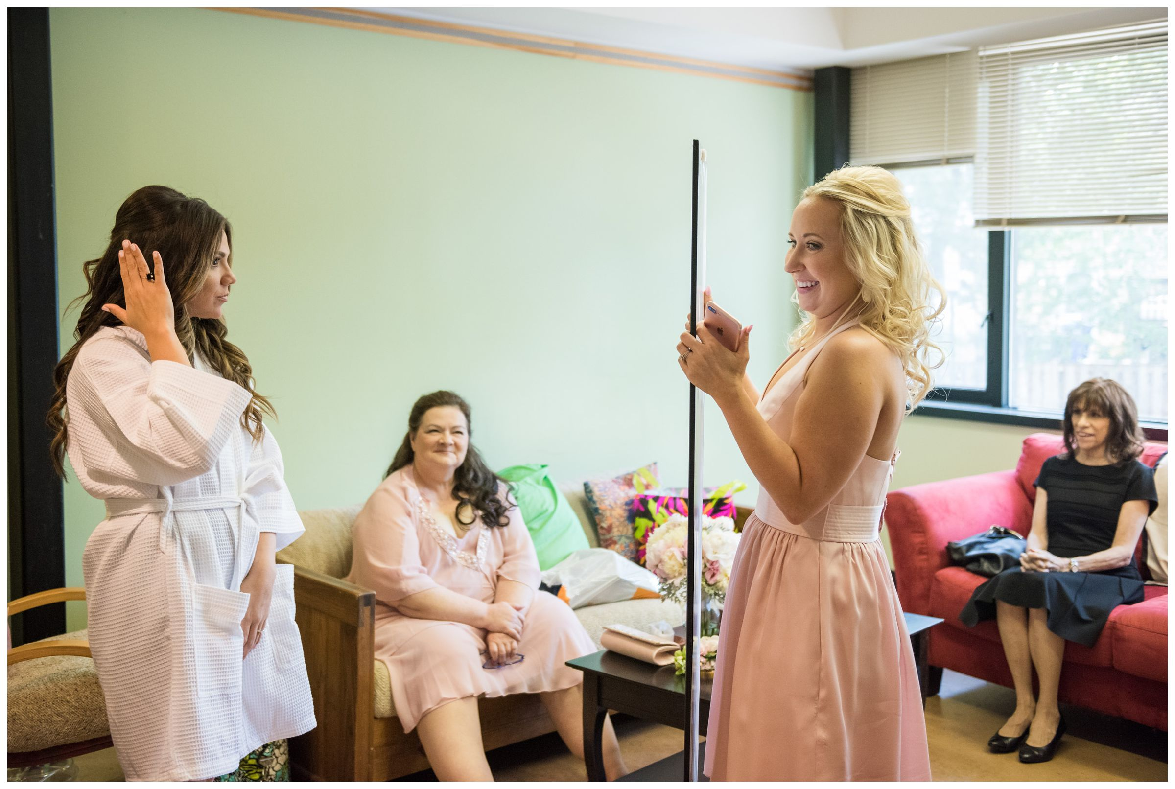 bride getting ready before wedding at the Unitarian Universalist Church in Arlington, Virginia