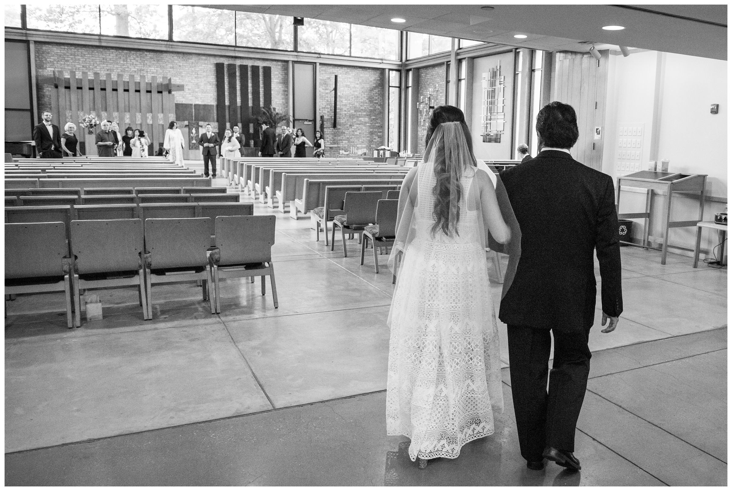 bride and father processional during wedding ceremony at the Unitarian Universalist Church in Arlington, Virginia
