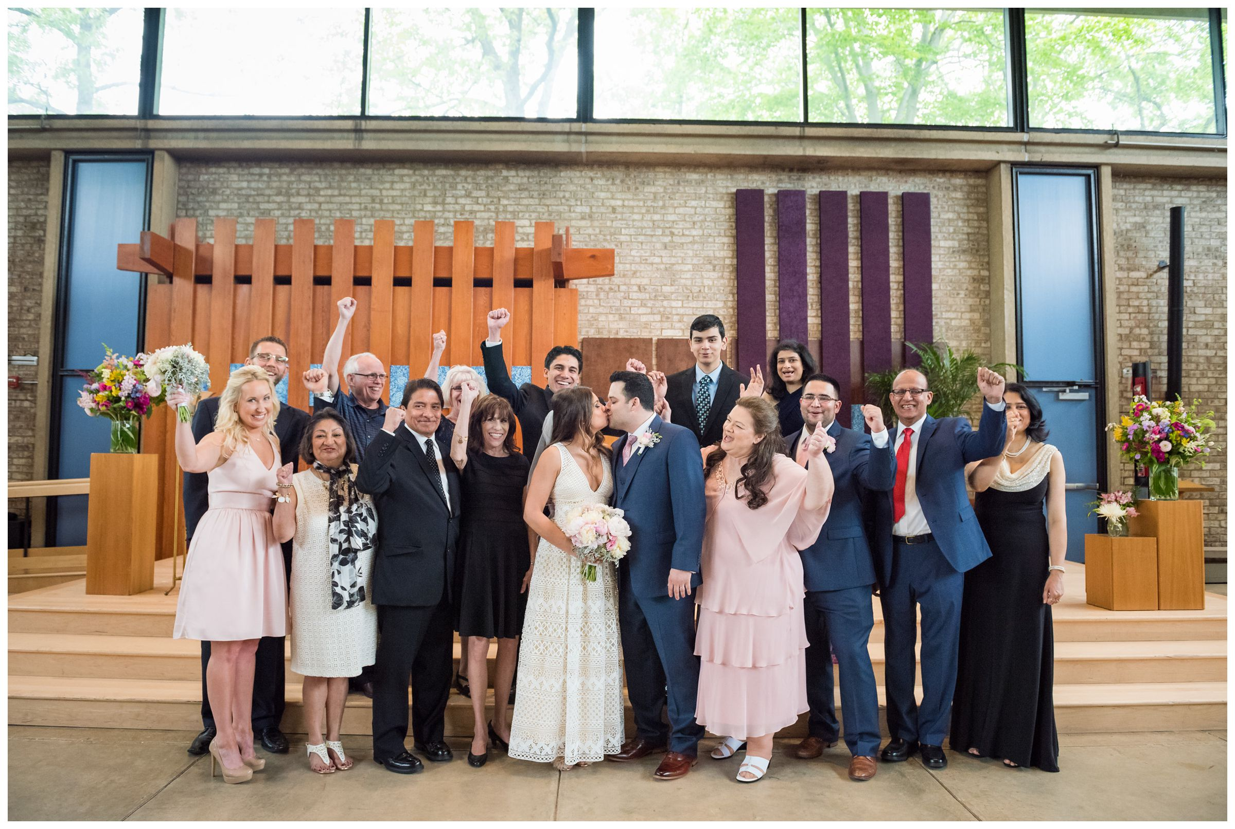 group photo of intimate wedding ceremony at the Unitarian Universalist Church in Arlington, Virginia
