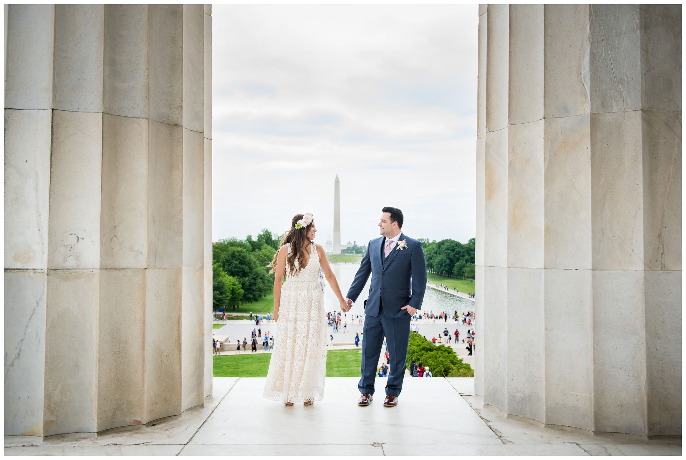 bride and groom portraits in front of reflecting pool and Washington Monument during DC monument wedding day on National Mall