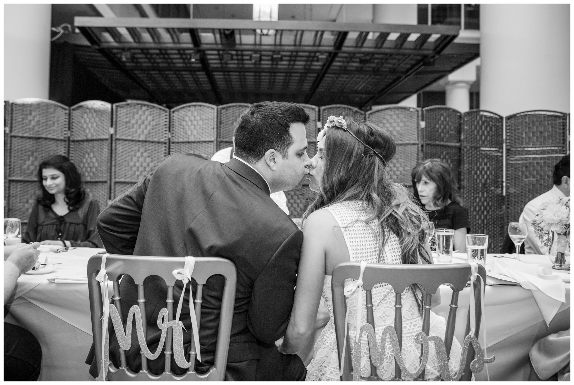 bride and groom kissing during intimate wedding reception dinner at Old Ebbitt Grill in Washington, D.C.