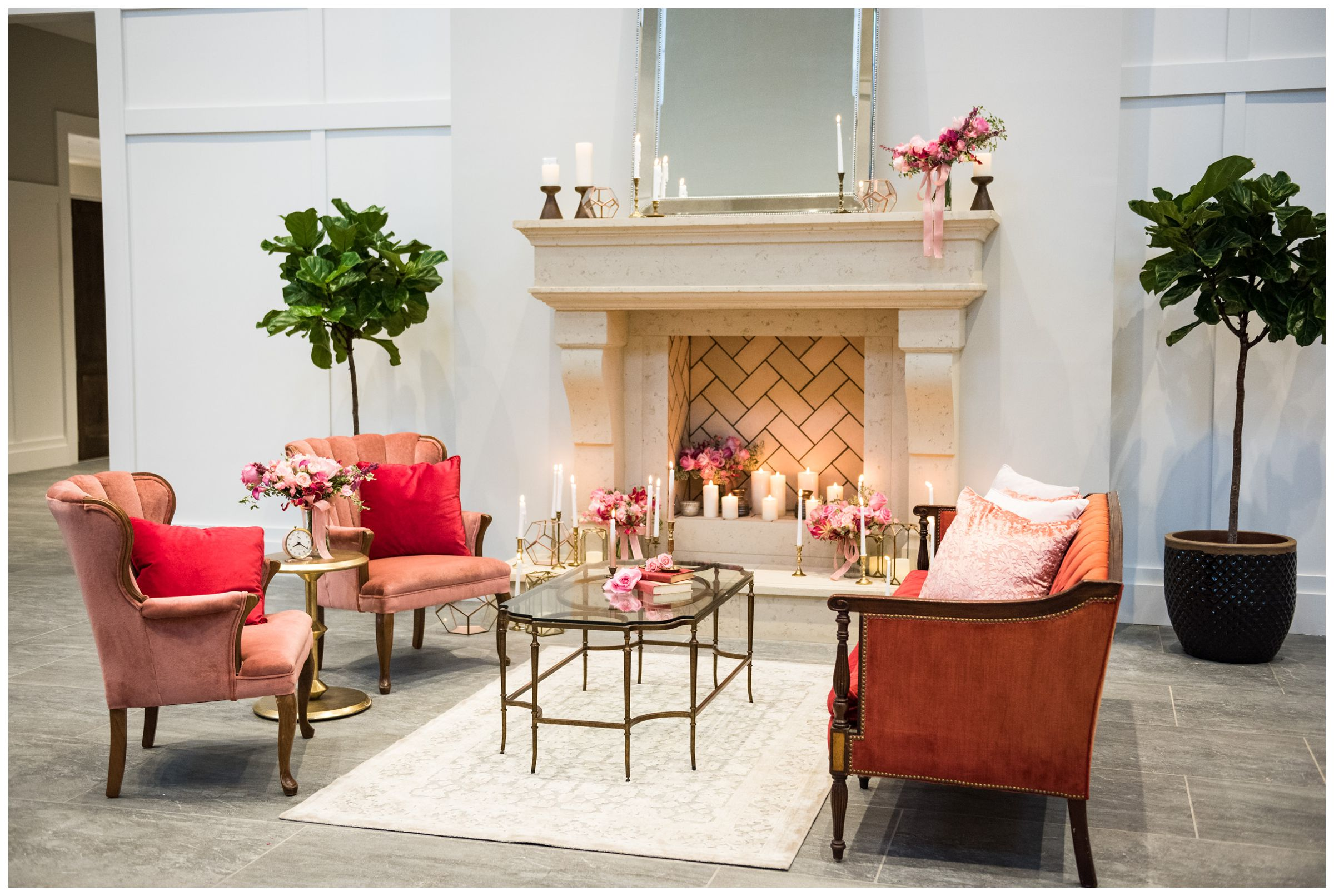 lounge area with pink accents and fireplace at the Estate at New Albany wedding venue near Columbus, Ohio
