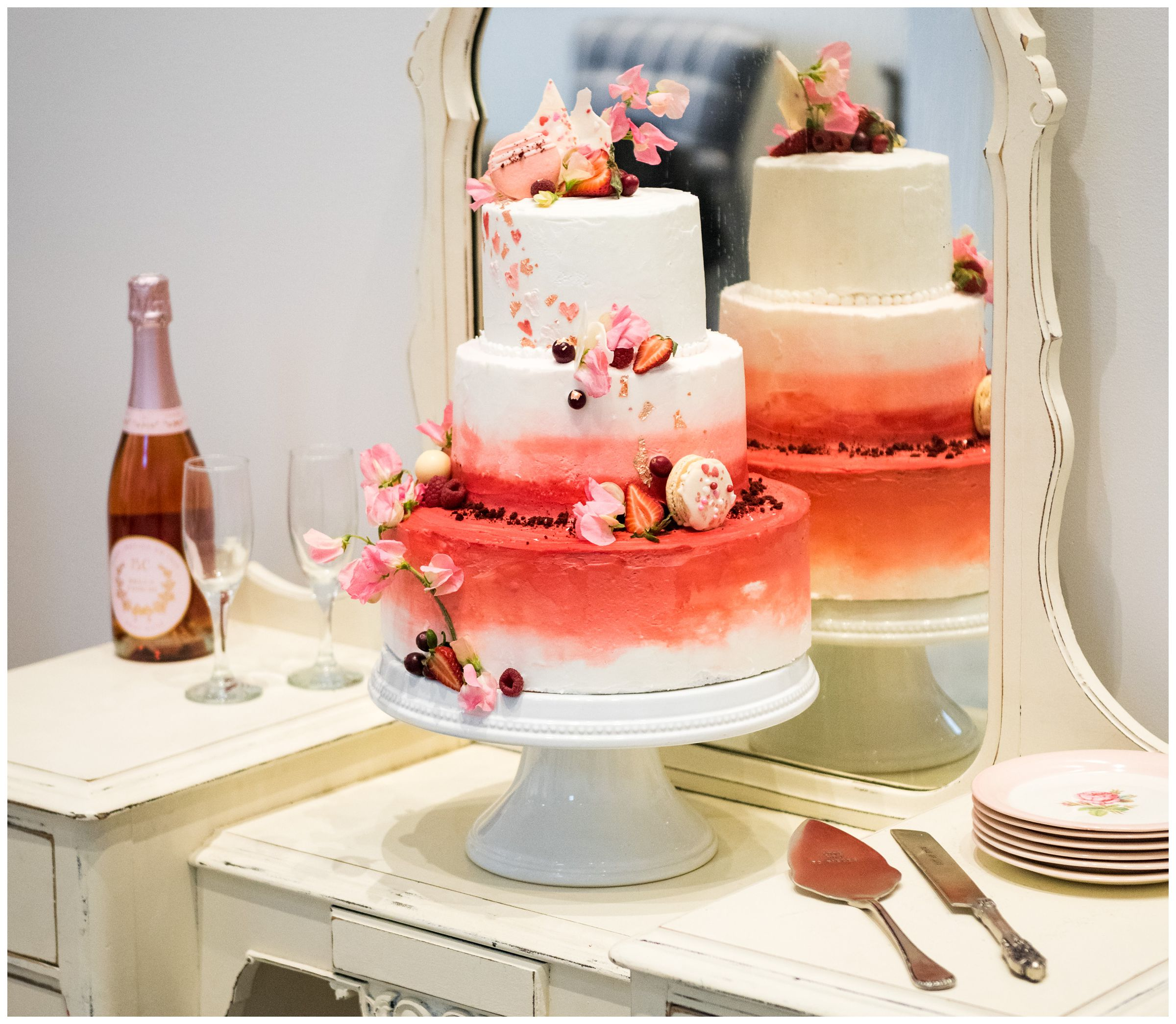 wedding cake with pink macaroons and fruit by Ovenbird Baking in Columbus, Ohio
