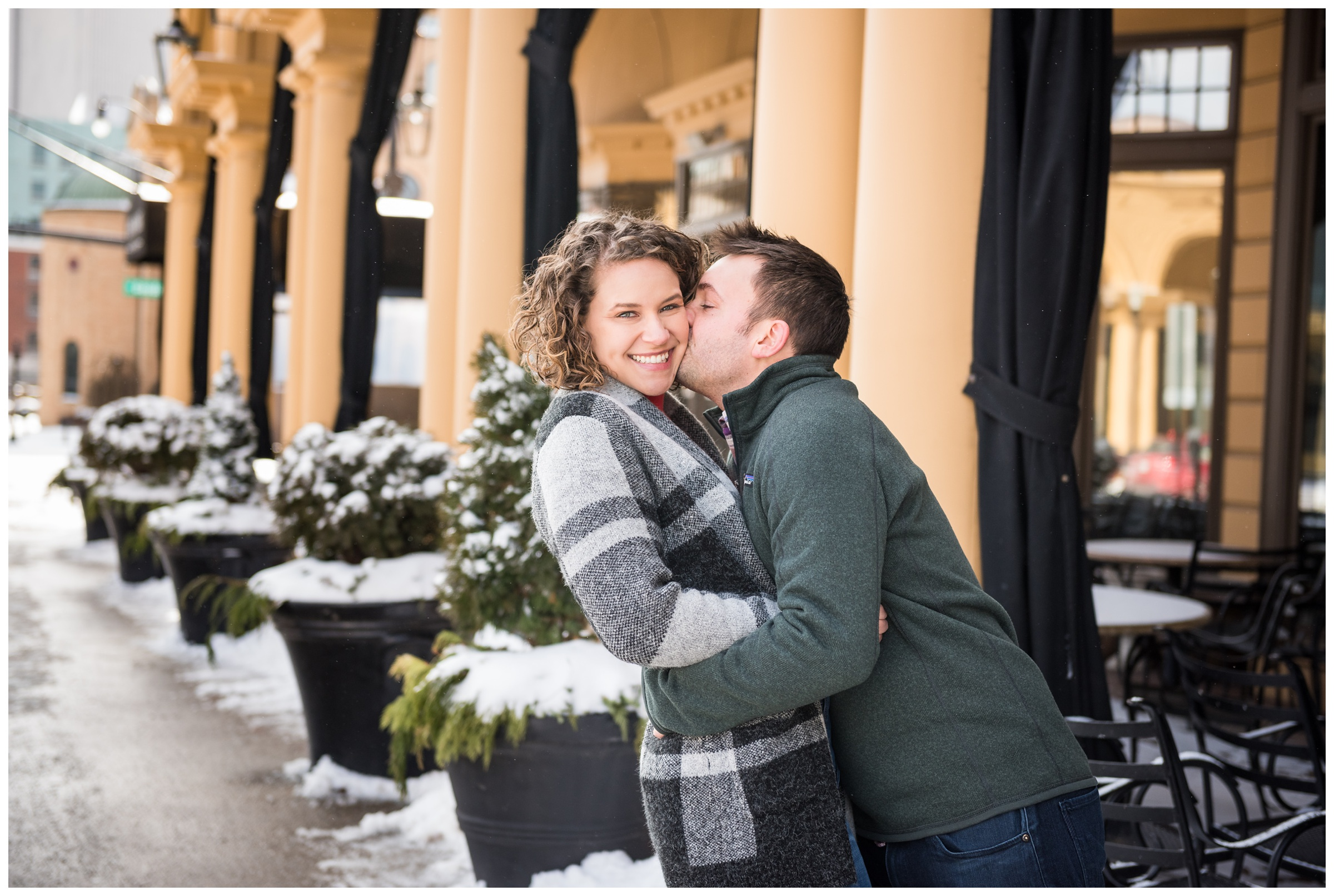 engaged couple on High Street in the Short North neighborhood of Columbus, Ohio during snowy winter engagement session
