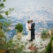 wedding photo by lake with leaves and greenery