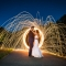 bride and groom with ring of fire raining fire nighttime long exposure wedding photography