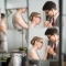 couple getting ready for wedding reflected in mirror