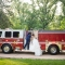 bride and groom wedding photo with firetruck