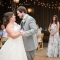 bride and groom first dance candid by rustic barn wedding photographer