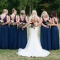 bride with bridesmaids in long navy gowns