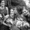 bride laughing with bridesmaids candid wedding photography