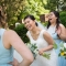 candid photo of bride and bridesmaids laughing by Columbus wedding photojournalist