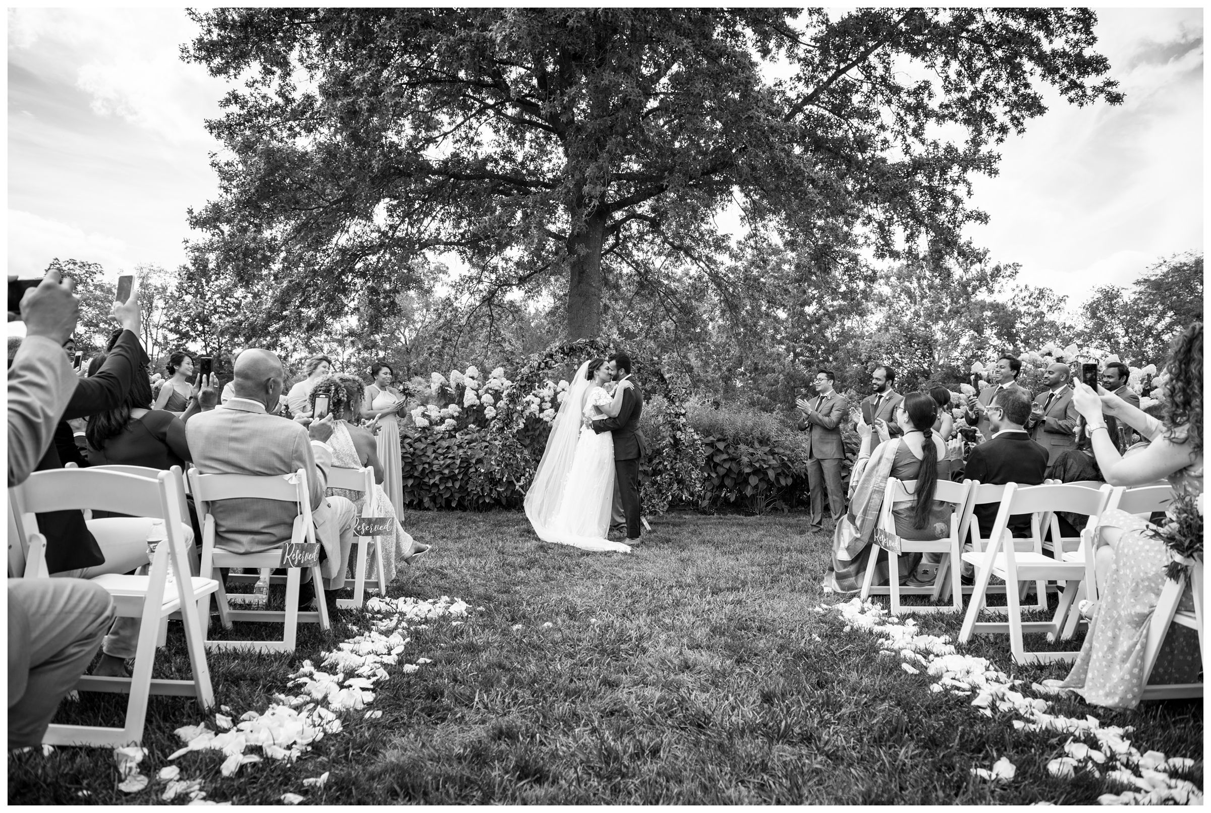 black and white photo of first kiss at wedding in Columbus