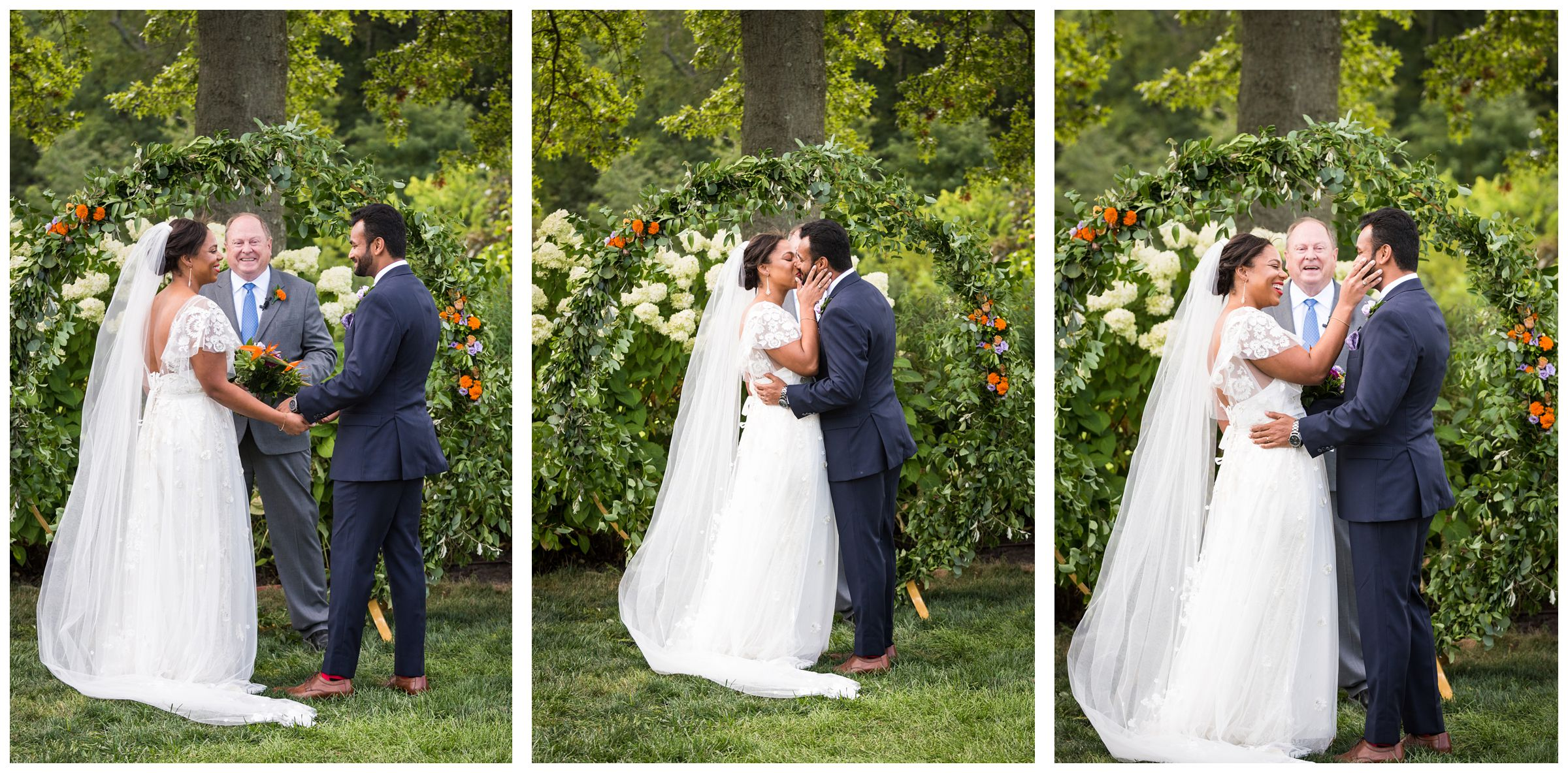 wedding ceremony first kiss in front of floral moongate arch during rustic wedding at Jorgensen Farms Historic Barn