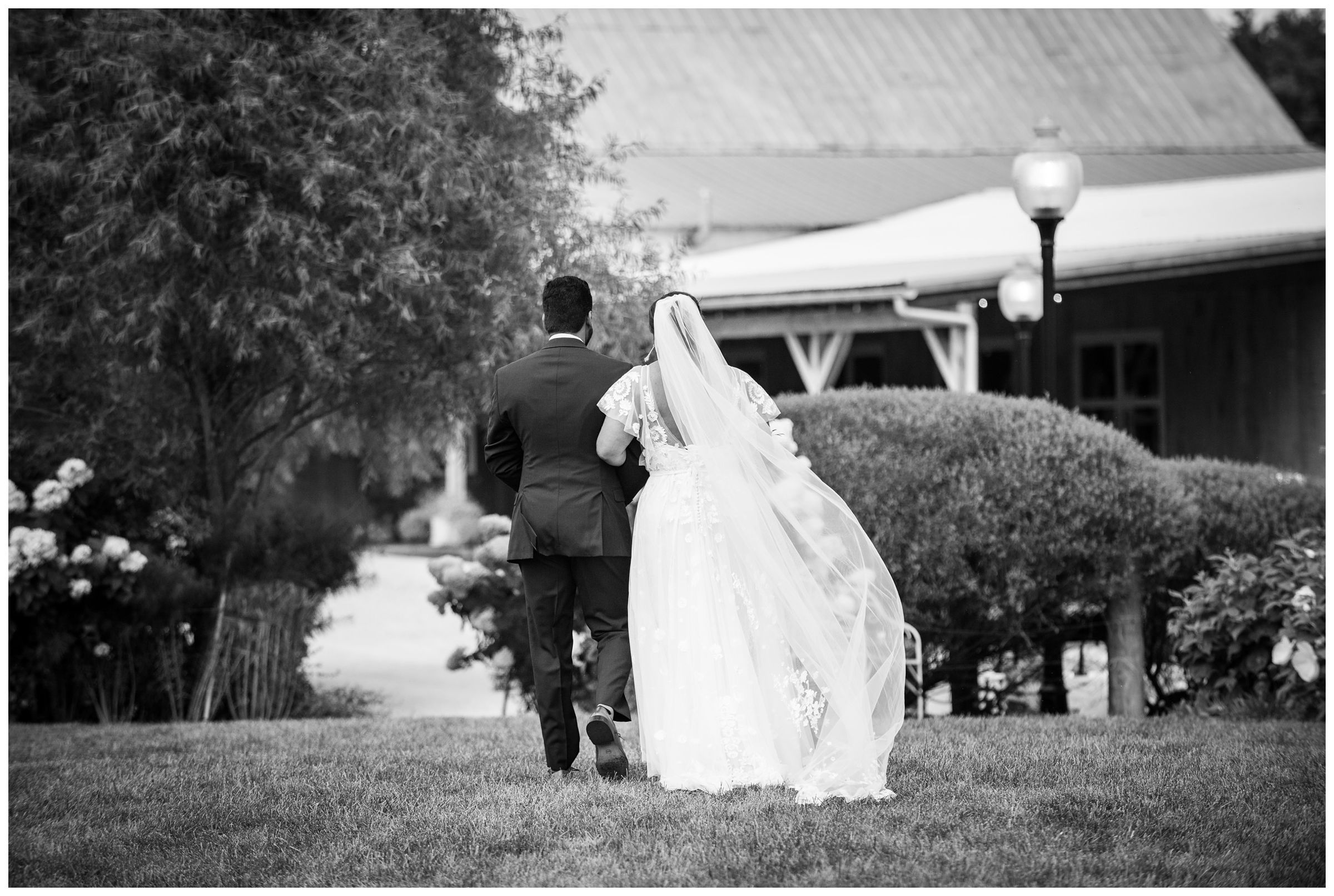 Bride and groom after wedding ceremony at Jorgensen Farms Historic Barn in Columbus