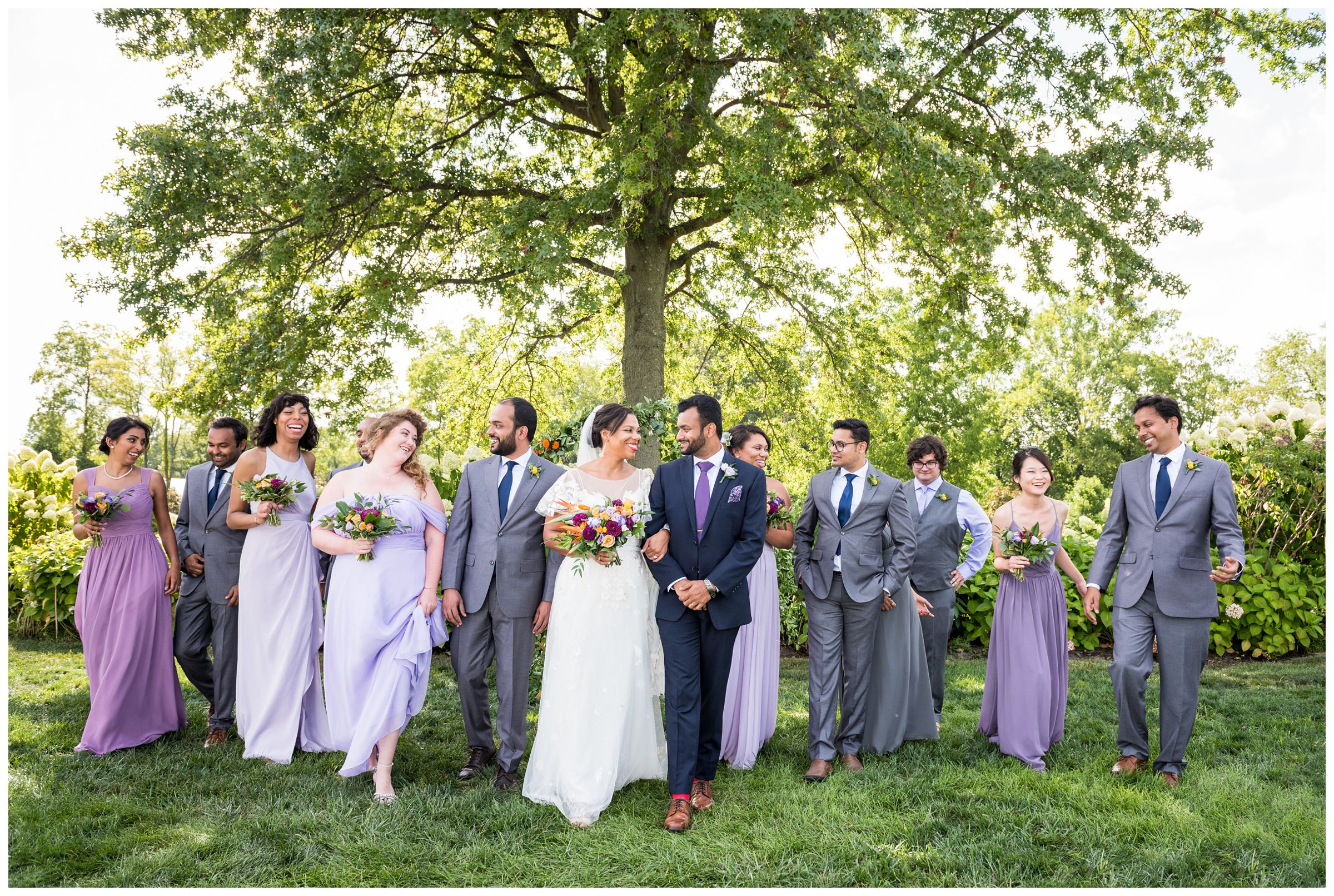light purple, blue and gold wedding party with diverse ethnicities