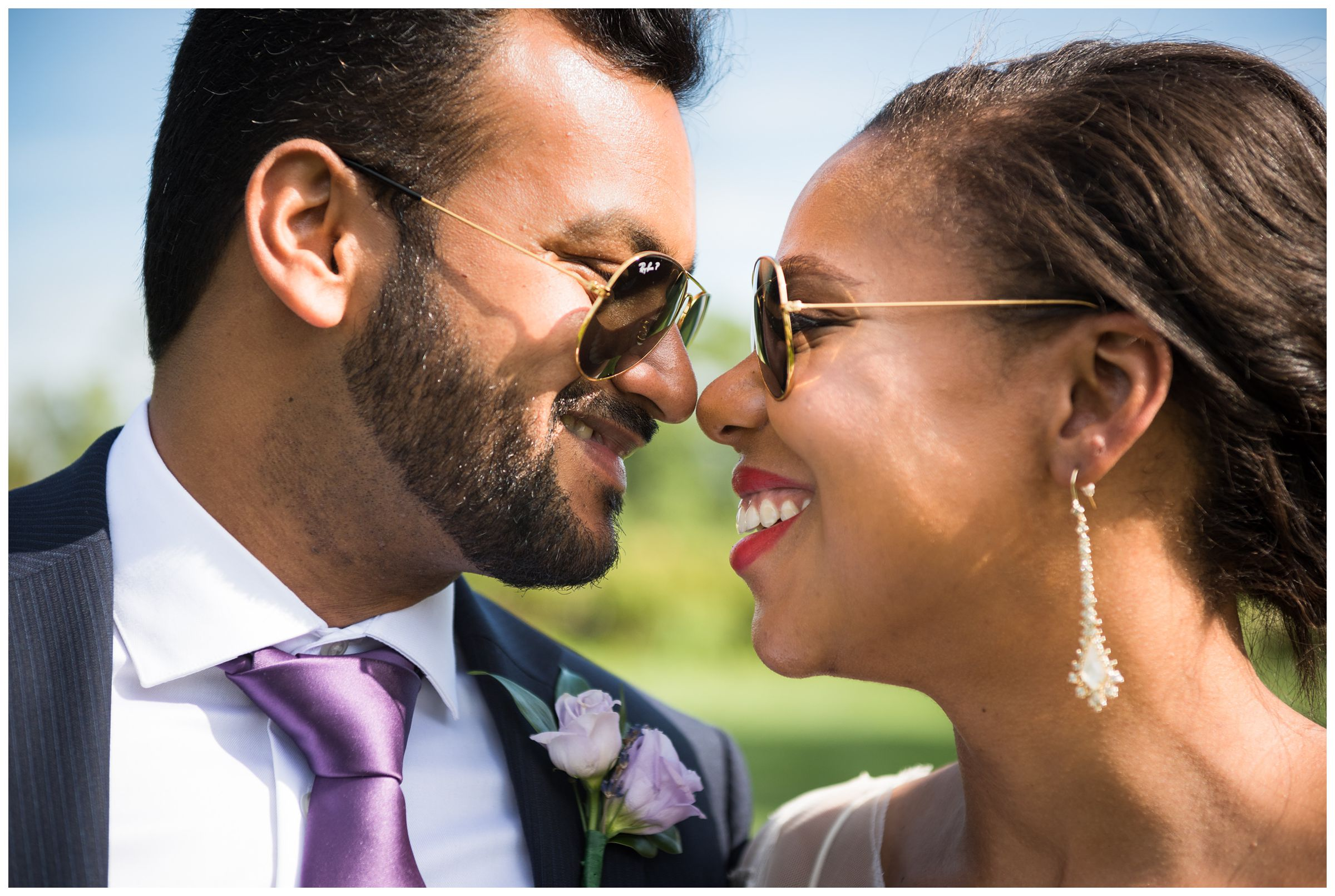 bride and groom wearing Ray Ban sunglasses by Ohio wedding photographer
