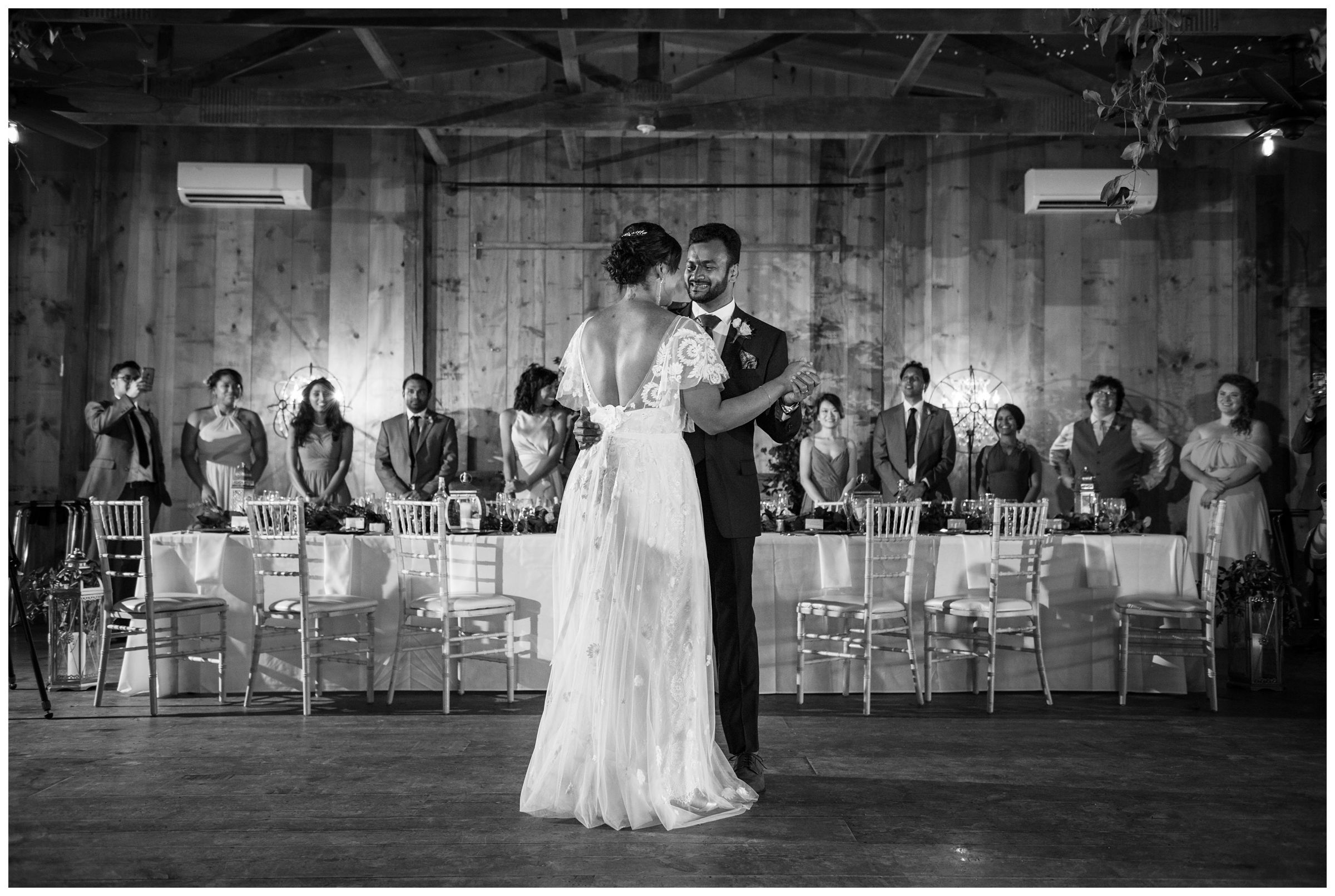 bride and groom first dance during rustic wedding reception at Jorgensen Farms in Columbus Ohio