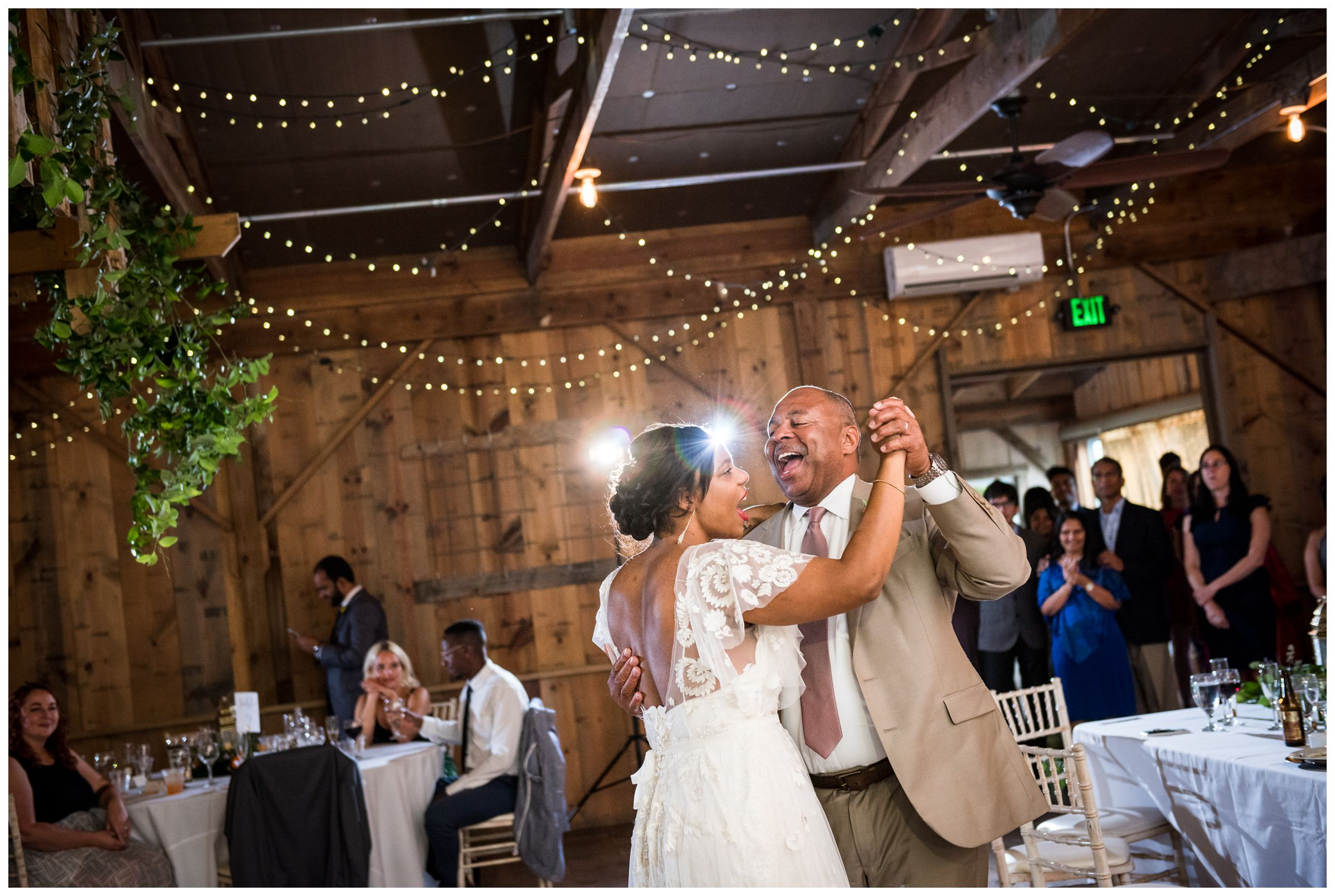 father daughter dance during rustic wedding reception at historic barn
