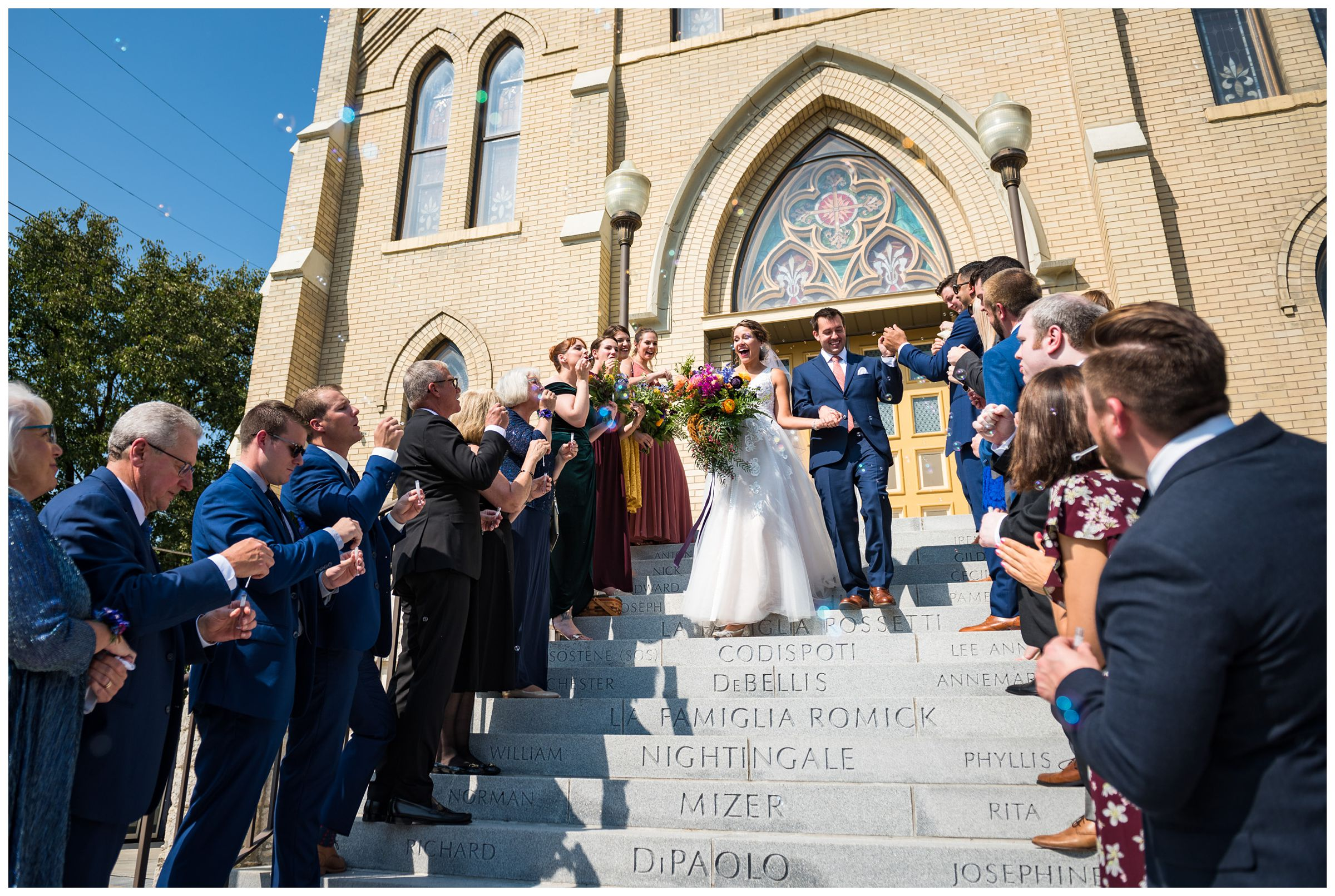 bubble exit on stairs after wedding ceremony at St. John the Baptist Catholic Church in downtown Columbus, Ohio