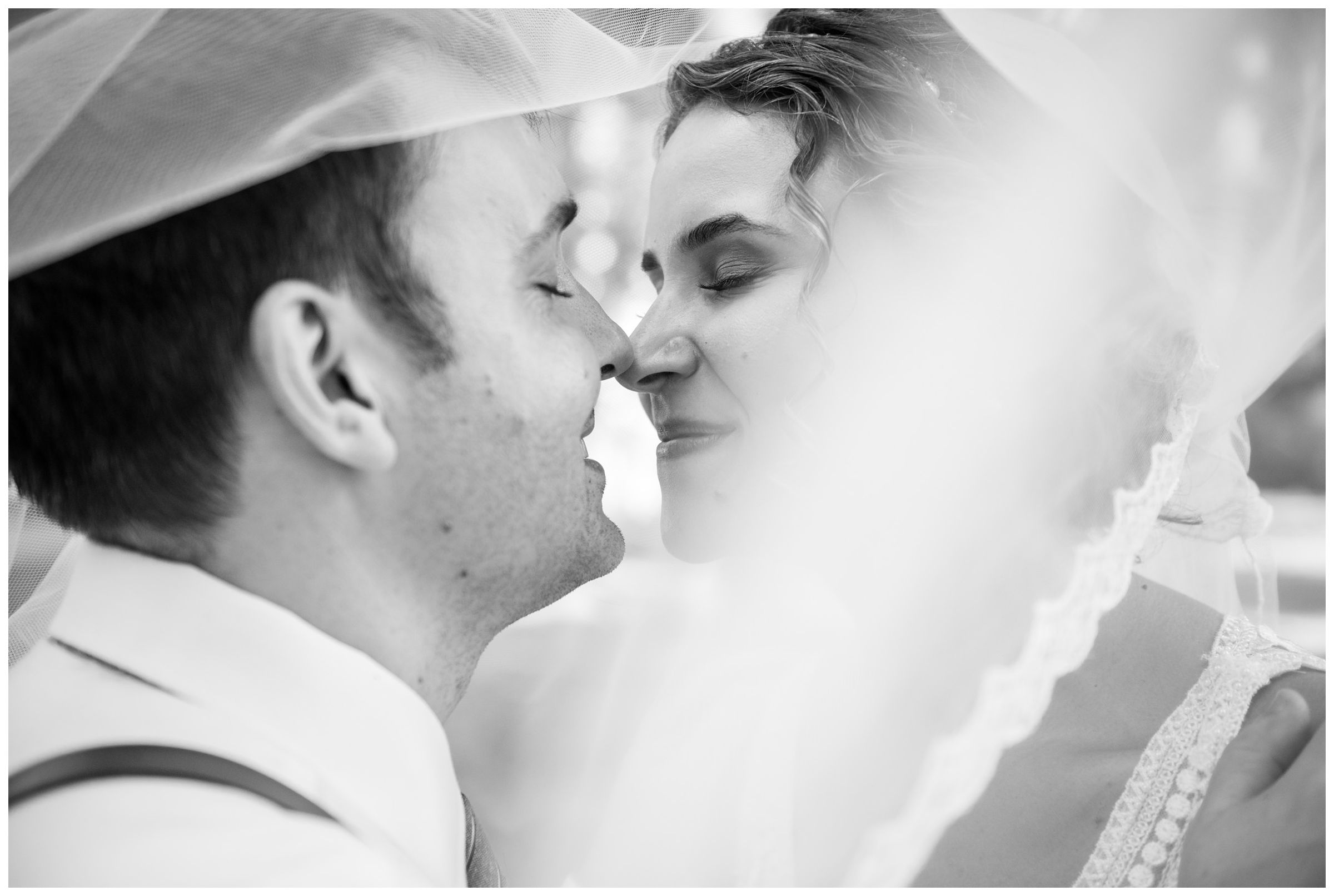 bride and groom black and white wedding photo under veil during rustic barn wedding in Lancaster, Ohio