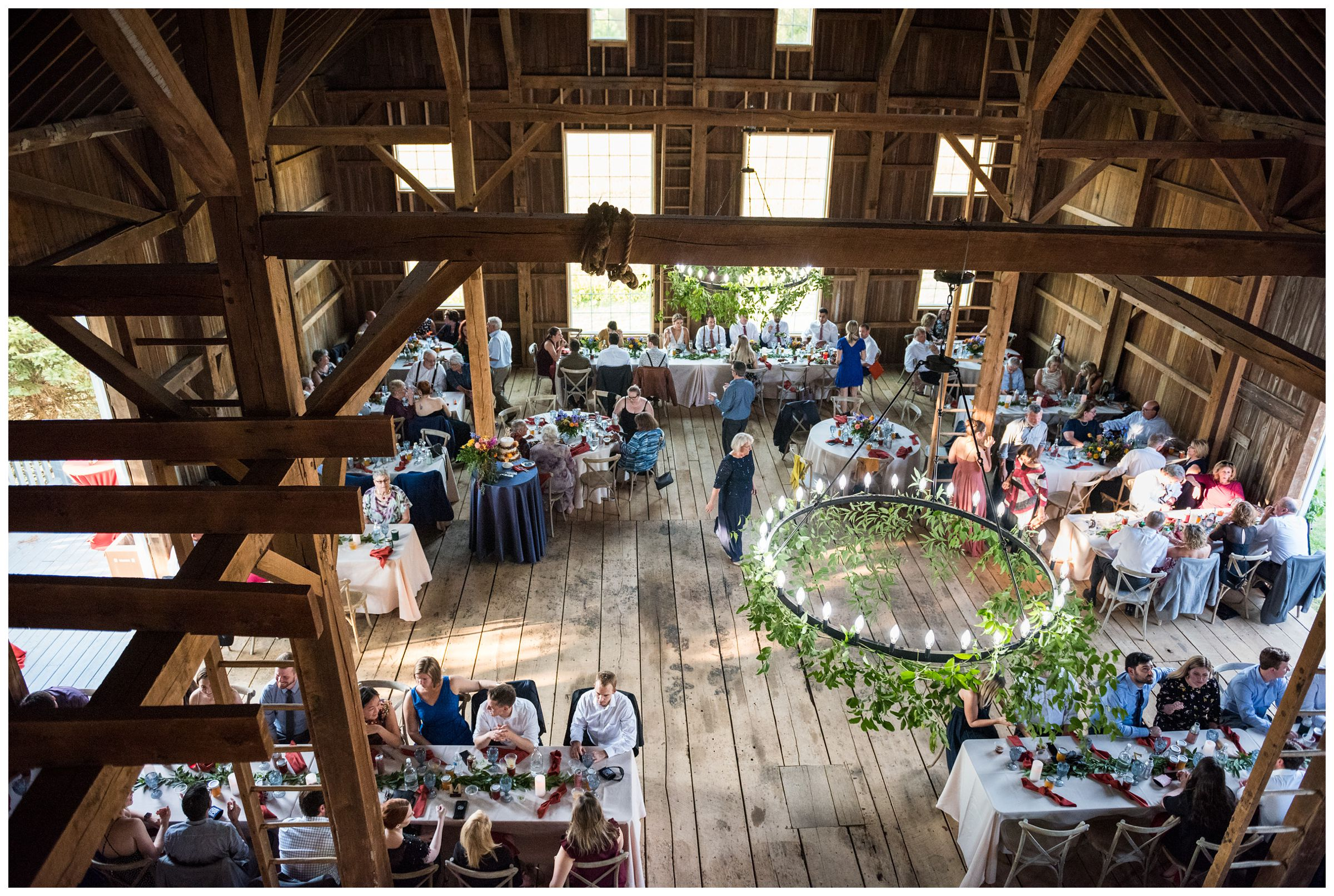 rustic barn wedding reception with greenery at family farm in Lancaster, Ohio