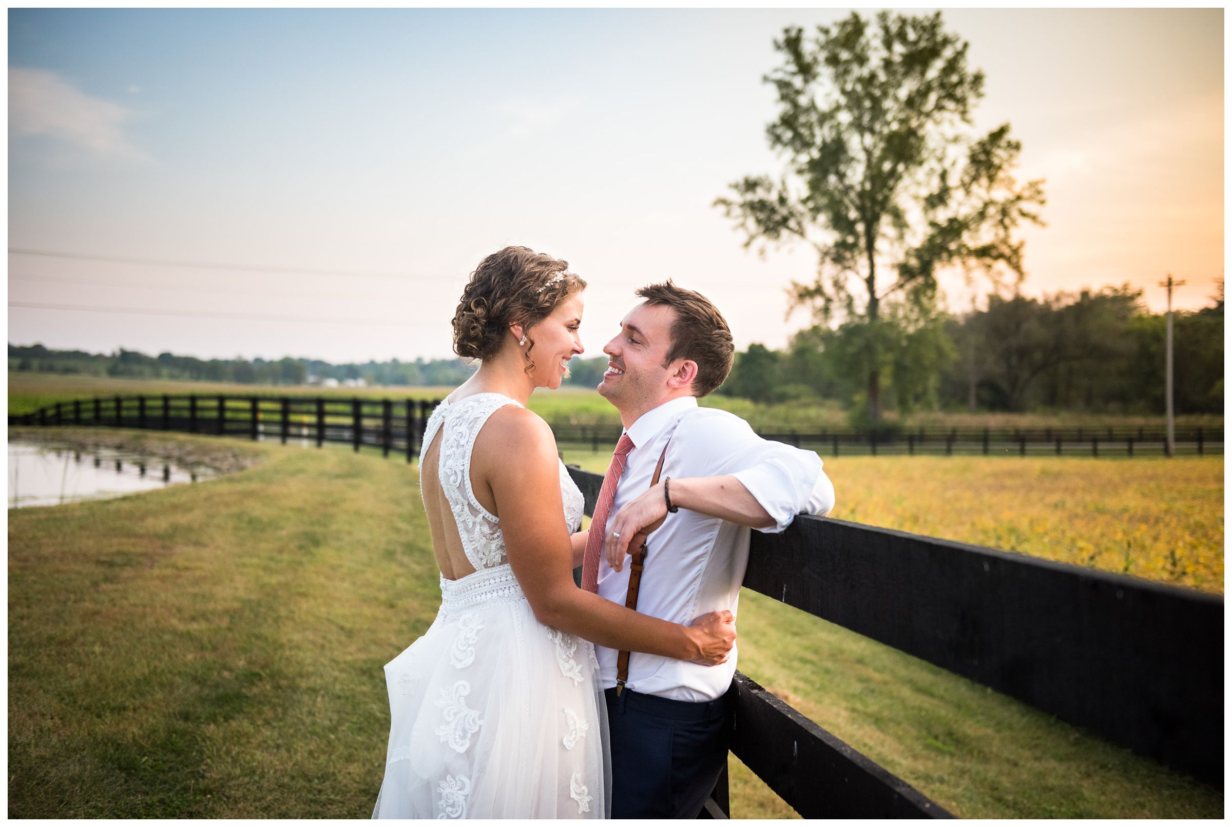 bride and groom portrait at sunset during rustic barn wedding captured by Lancaster Ohio wedding photographer